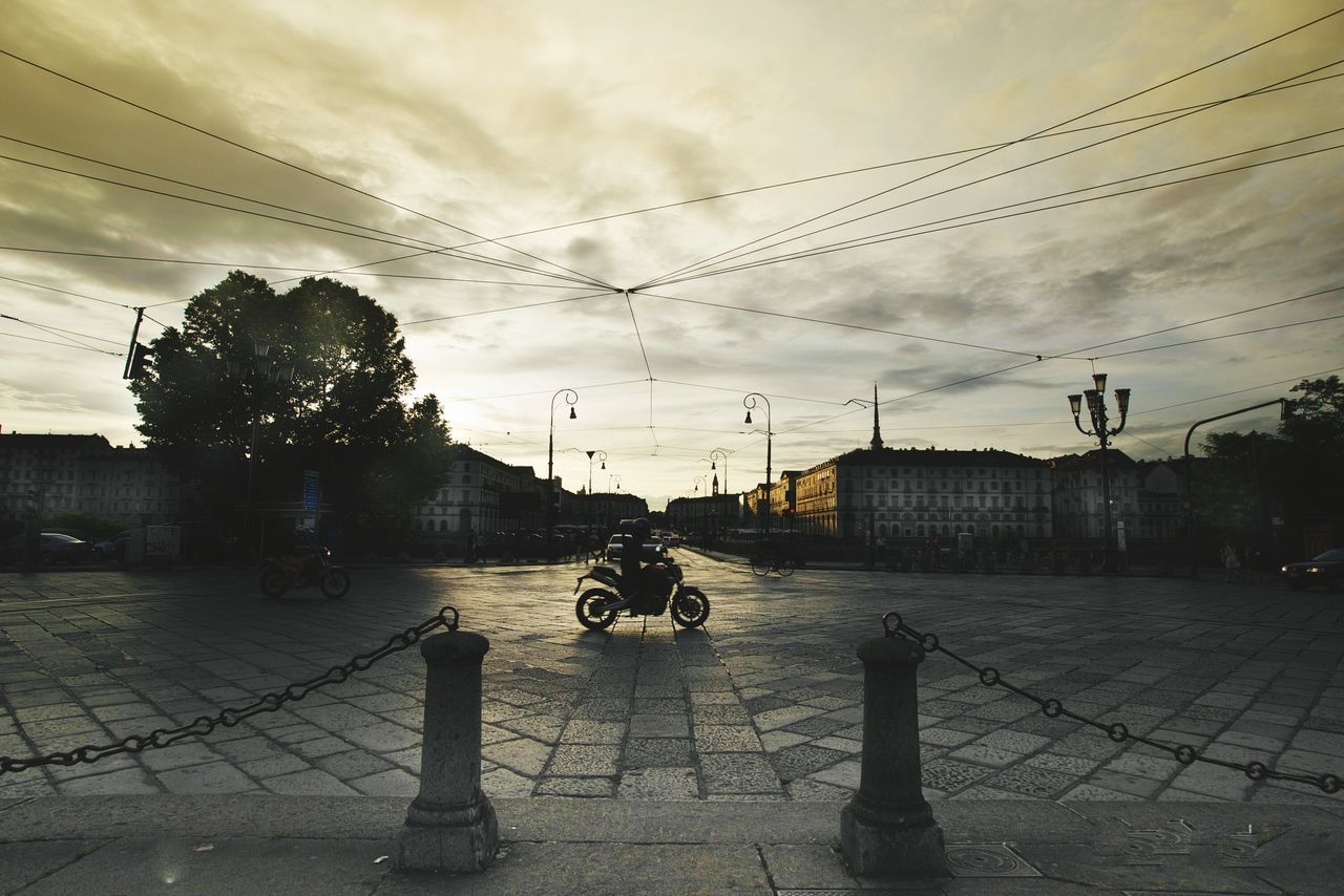 Torino Evening Sky Clouds And Sky Motorcycles Rider Centre Old Buildings My Point Of View Street Photography Taking Photos Sunset Yellow Walking Around The City  One Shot Sky_collection Electricity  Cables Sunlight Clouds Collection Torino , La Mole