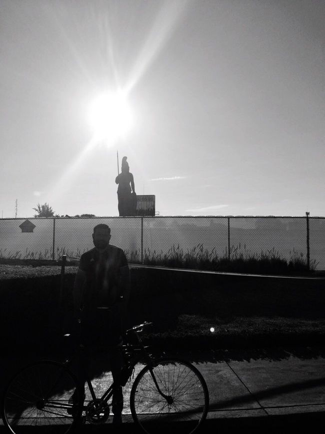 Minerva Bicycle Sky Mode Of Transport Sunlight Real People Transportation Land Vehicle Lifestyles Outdoors Cycling One Person Rear View Leisure Activity Full Length Men Stationary Sun Day Water Nature Blackandwhite Sunlight