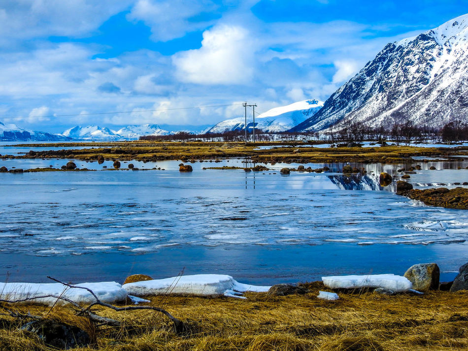 Blue Blue Sky Cloud Cloud - Sky Electricity Pole Fjord Fjørd Frozen Grass Ice Lake Landscape Mirrored Reflection Mountain Nature Norway Outdoors Reflection Reflections Scenics Sea Snow Snowcapped Mountain Water Yellow