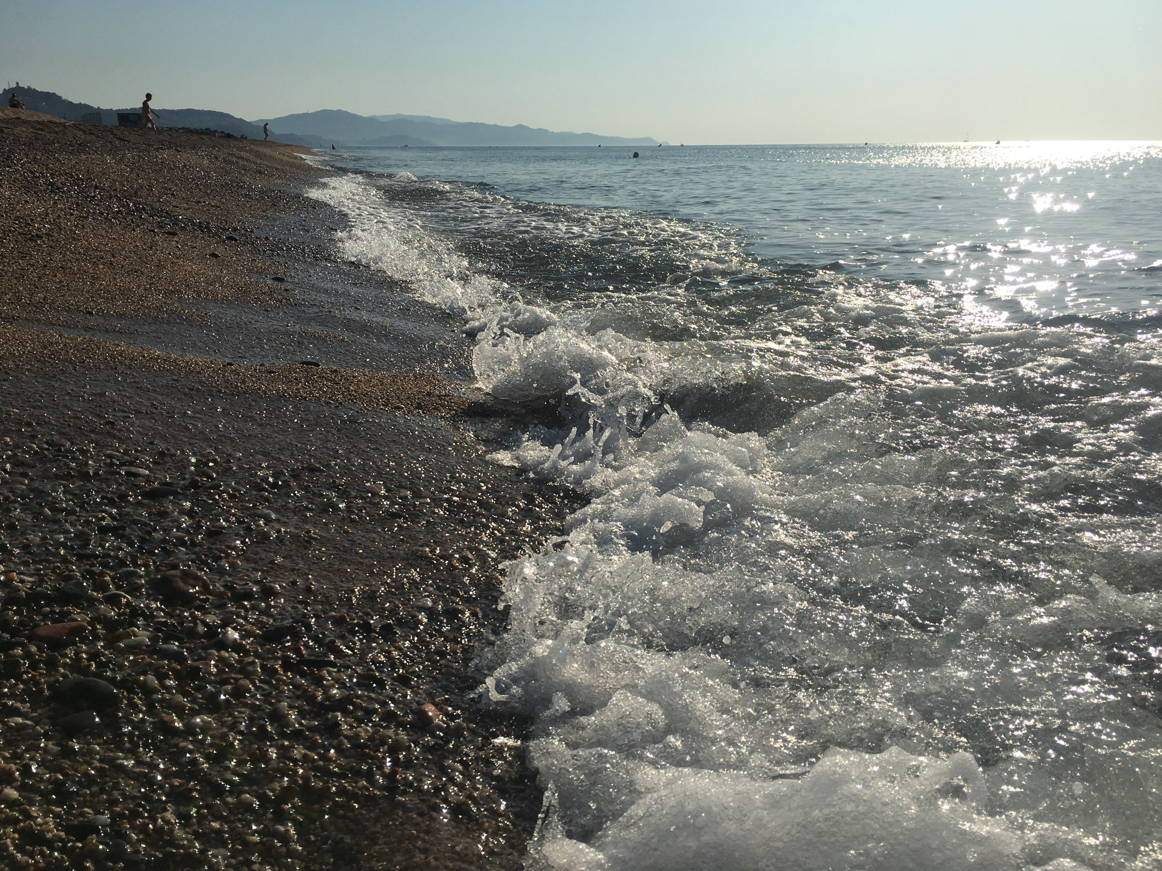 water, sea, horizon over water, wave, scenics, beauty in nature, shore, nature, splashing, tranquility, tranquil scene, motion, sunlight, idyllic, sky, outdoors, day, remote, rippled, non-urban scene, blue, ocean, sunny