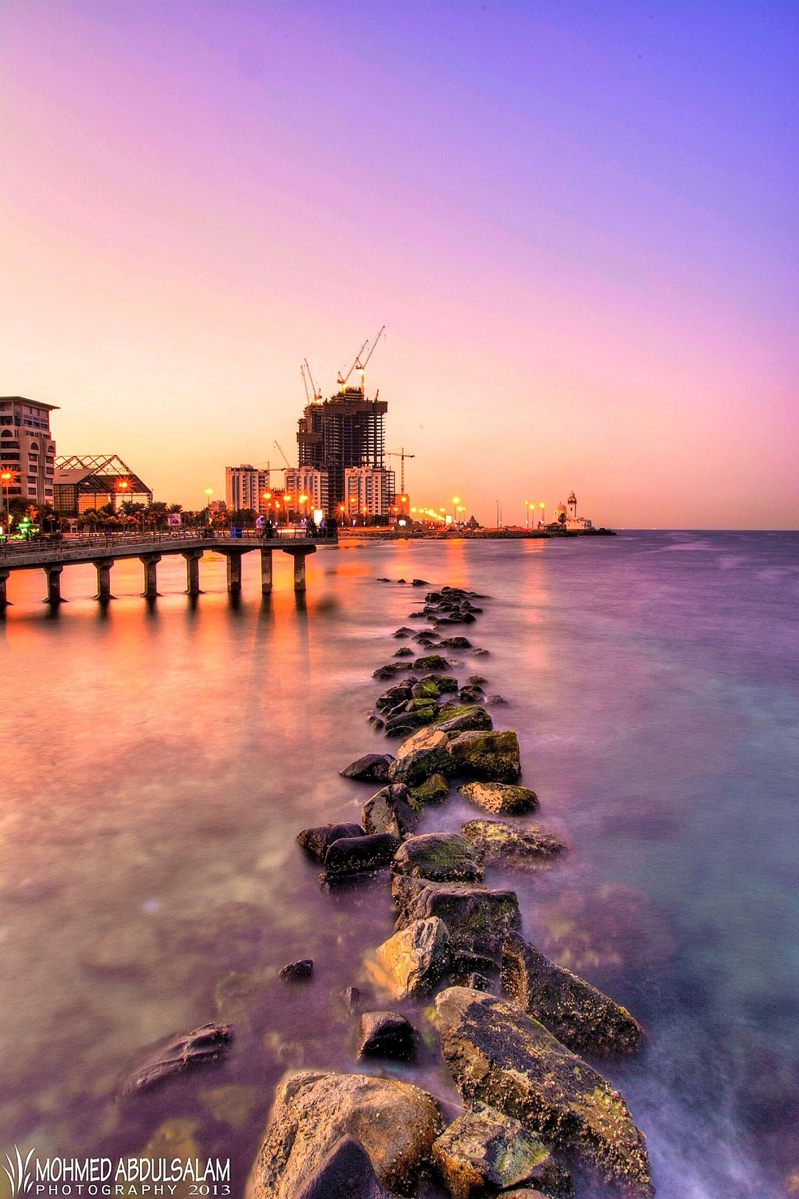 water, built structure, architecture, connection, bridge - man made structure, sunset, sea, clear sky, river, reflection, waterfront, bridge, copy space, sky, building exterior, tranquil scene, engineering, scenics, tranquility, nature