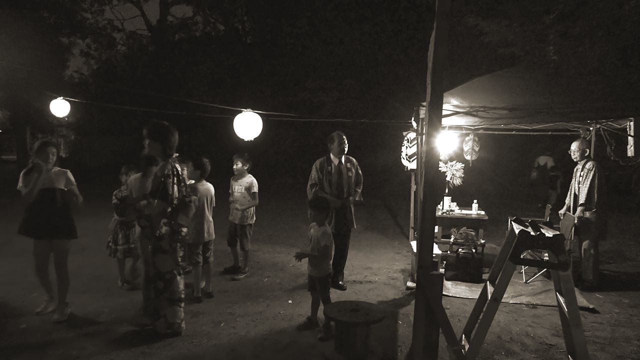 night, illuminated, real people, lighting equipment, men, standing, outdoors, lifestyles, full length, working, people