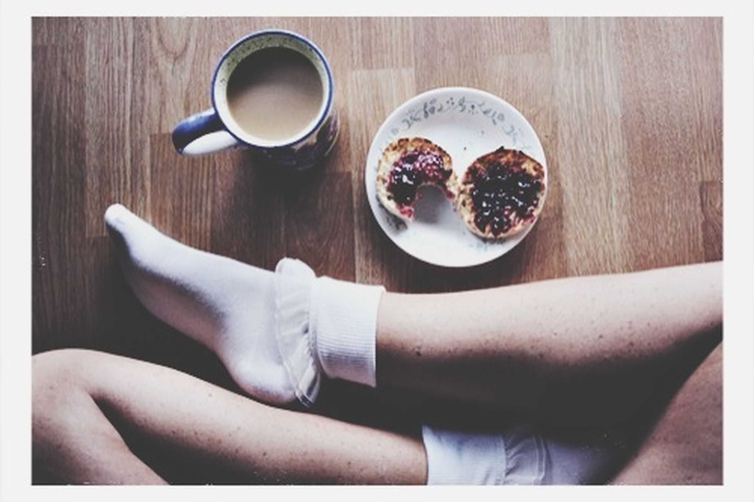 indoors, food and drink, person, table, drink, freshness, refreshment, coffee cup, holding, food, high angle view, part of, lifestyles, coffee - drink, coffee, transfer print