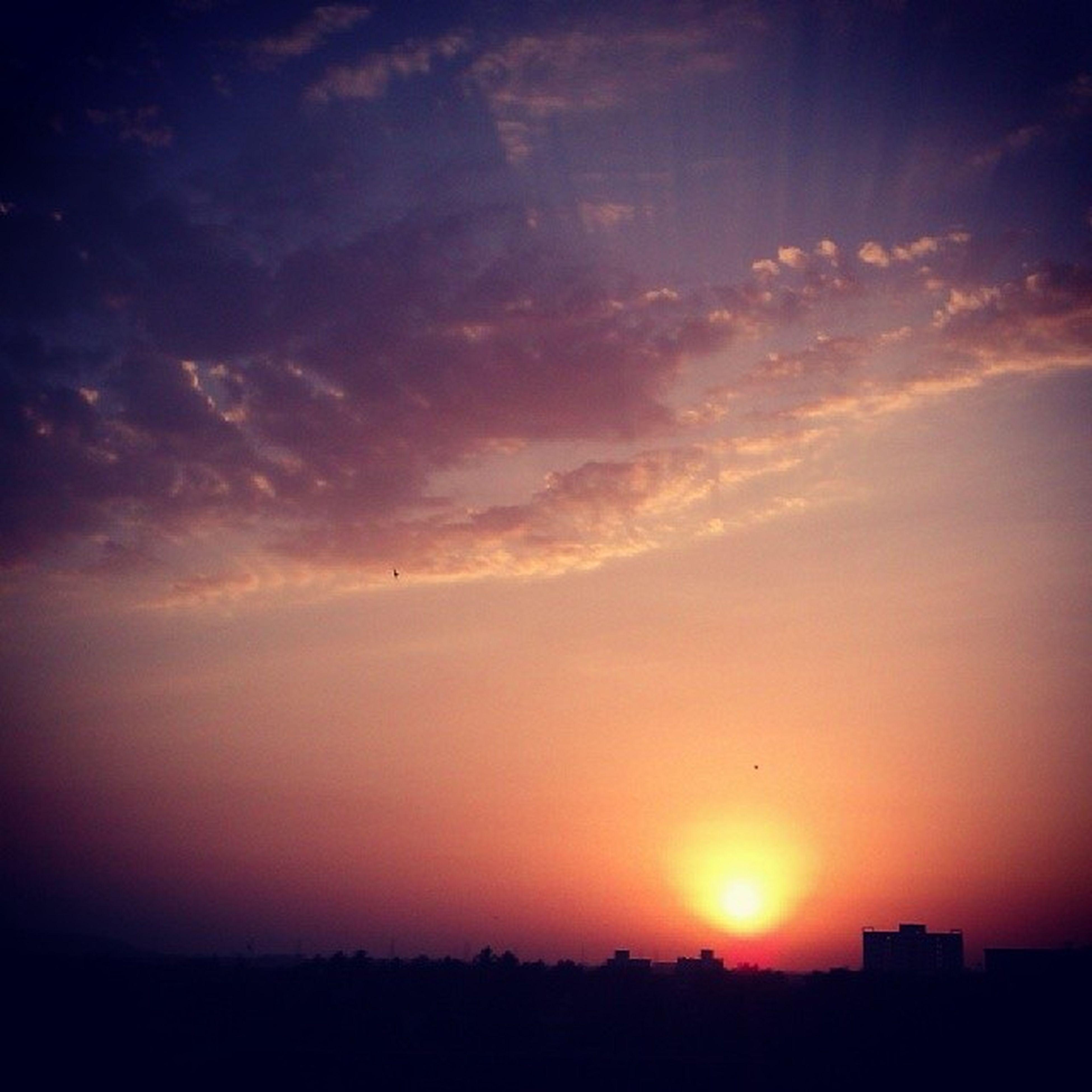 sunset, silhouette, sun, orange color, scenics, beauty in nature, sky, tranquil scene, tranquility, idyllic, nature, cloud - sky, sunlight, landscape, dramatic sky, sunbeam, building exterior, cloud, dark, outdoors