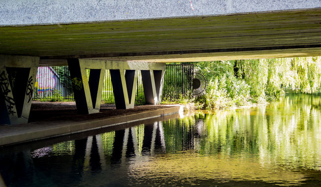 Beauty In Nature Bridge Canal Concrete Concrete Bridge Concretedesign Day Green Color Growth Idyllic Nature No People Outdoors Plant Reflection Rippled Scenics Supports Tranquil Scene Tranquility Water