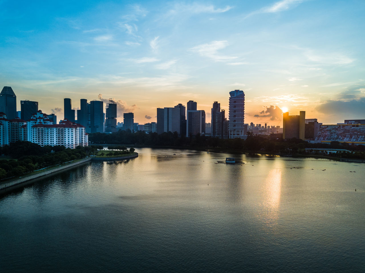 Architecture Building Exterior Built Structure City Cityscape Day Downtown District Drone  Dronephotography Growth Modern No People Outdoors River Singapore Sky Skyline Skyscraper Sunset Tall - High Travel Destinations Urban Skyline Water Waterfront