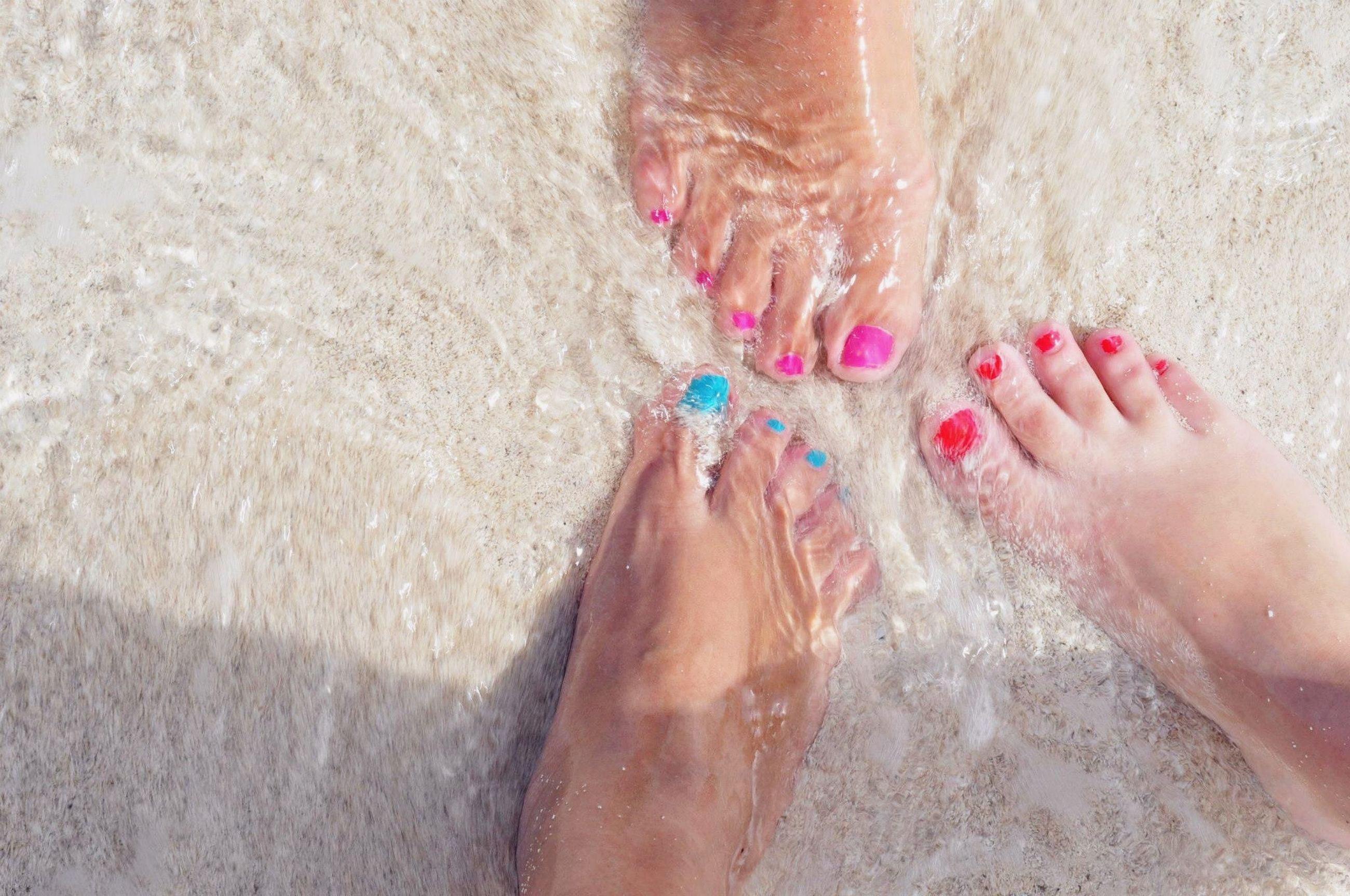 lifestyles, leisure activity, low section, person, barefoot, human foot, part of, beach, personal perspective, sand, high angle view, nail polish, water, sunlight