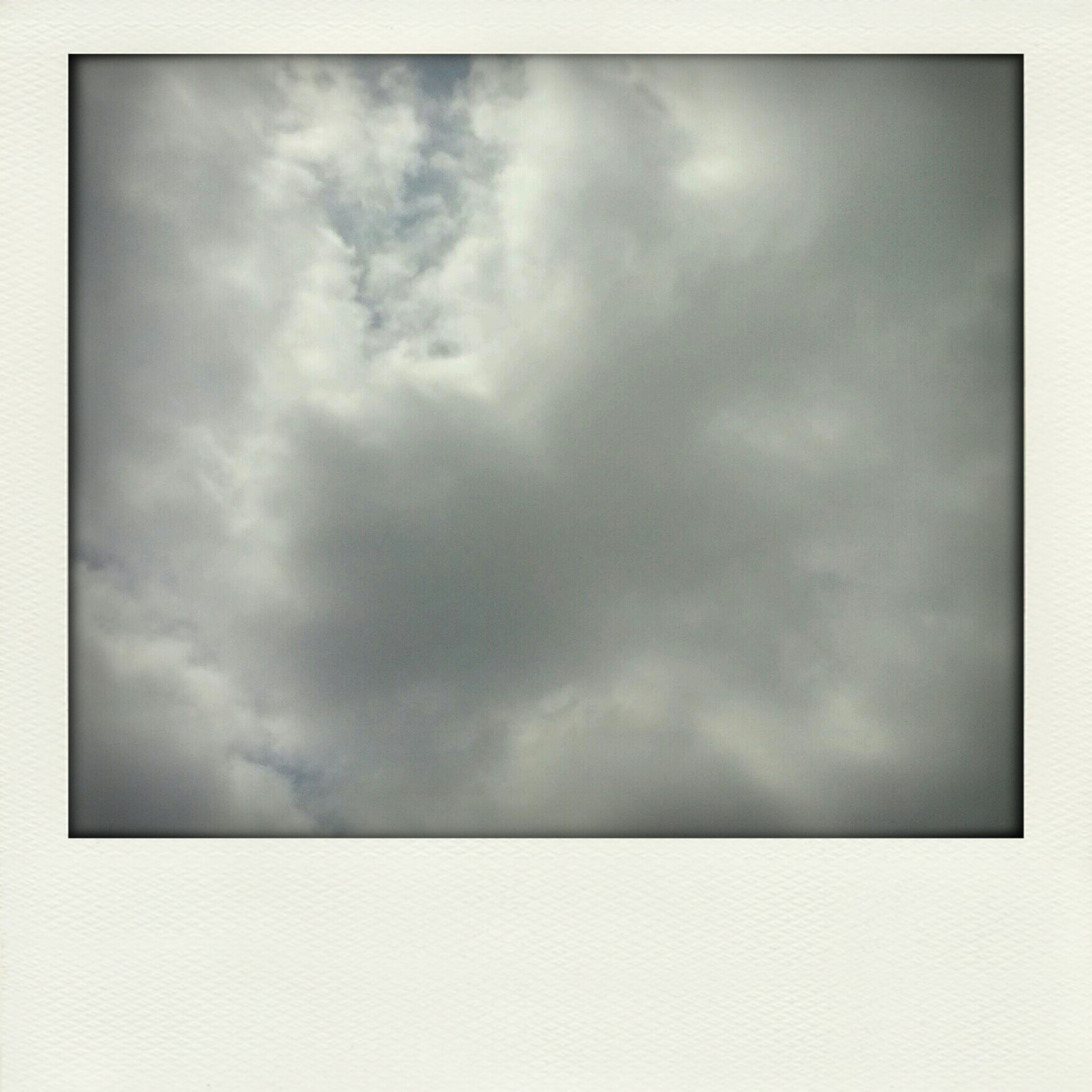 sky, cloud - sky, cloudy, transfer print, low angle view, overcast, weather, auto post production filter, beauty in nature, tranquility, nature, scenics, cloud, storm cloud, cloudscape, tranquil scene, sky only, outdoors, idyllic, no people