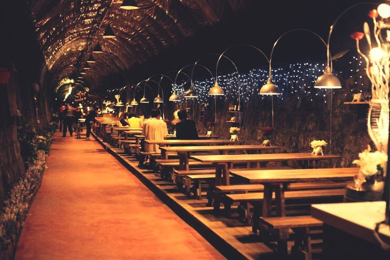 illuminated, table, night, real people, indoors, architecture