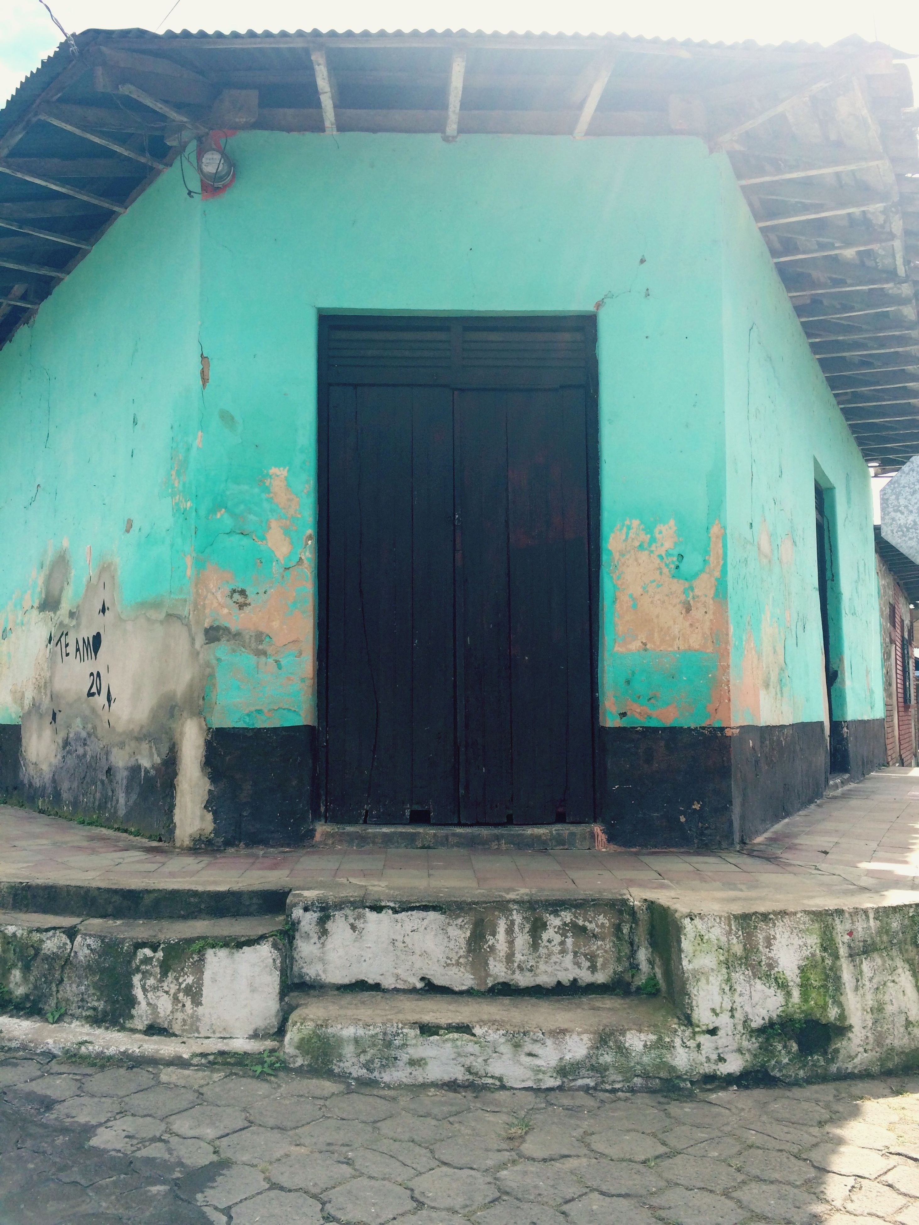 building exterior, architecture, built structure, door, graffiti, house, wall - building feature, weathered, closed, building, window, residential structure, old, abandoned, day, damaged, city, outdoors, blue, street