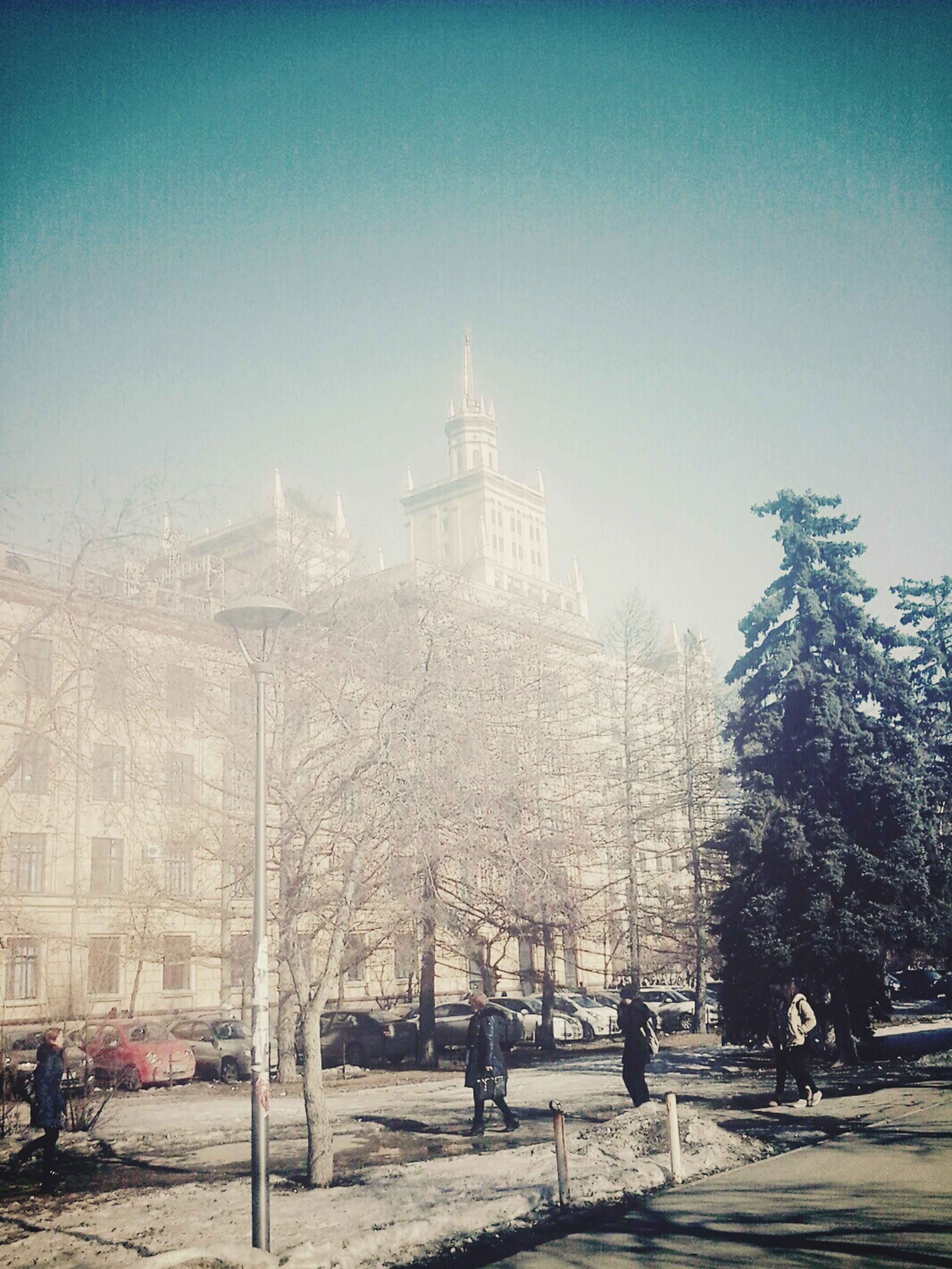building exterior, built structure, architecture, clear sky, winter, snow, cold temperature, tree, season, city, copy space, car, tower, road, bare tree, weather, street, incidental people, travel destinations, transportation