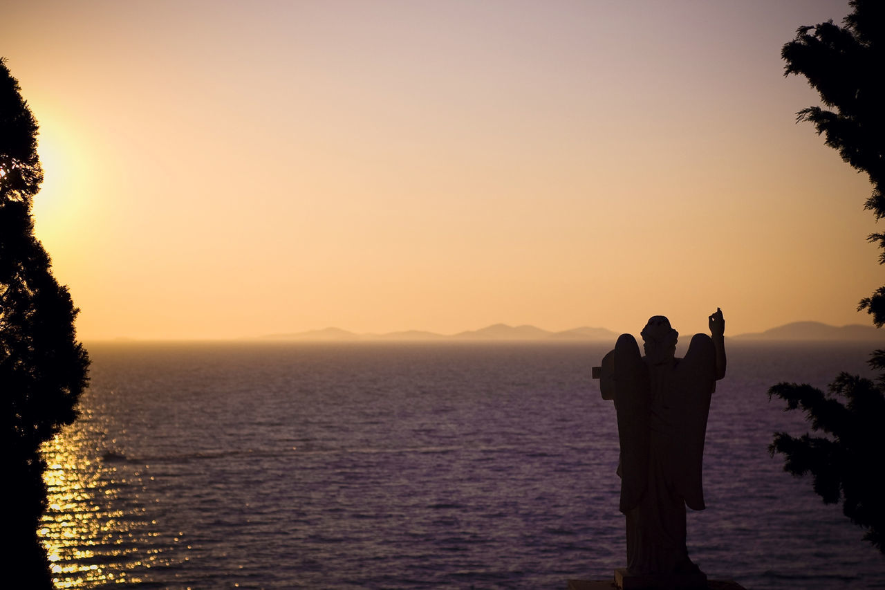 Angel And Sea Angel Statue Angel Wings Croatia Dalmatia Dalmatia Far Far Away Good Evening Horizon Horizon Over Water Outdoors Primošten Scenics Sculpture Sea Silhouette Silhouette Photography Sky Sun Going Down Sunset Travel Destinations Primosten, Croatia Vastness Miles Away