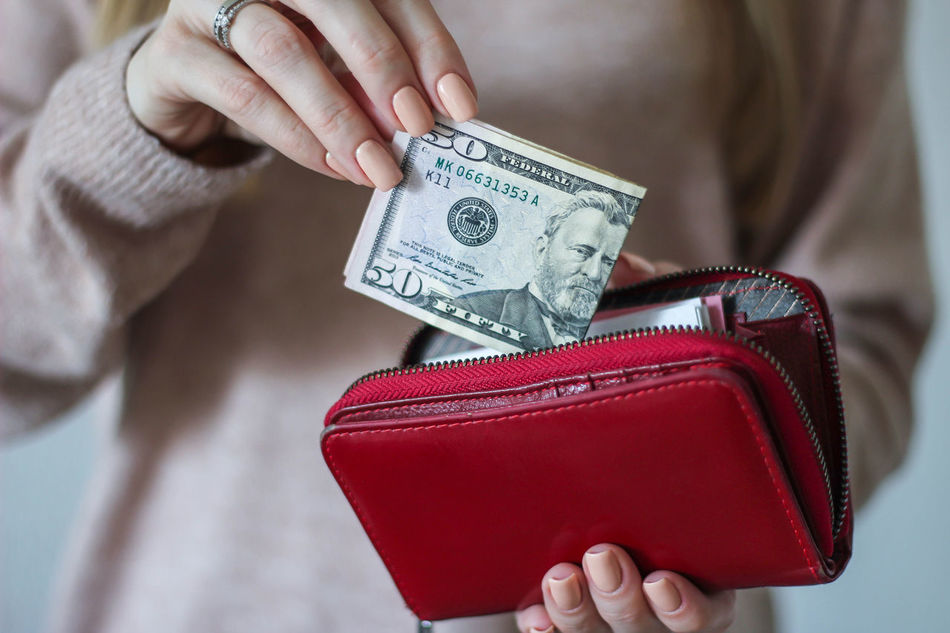 Woman is putting fifty dollars in the wallet Buying Close-up Dollar Earnings Fifty Dollars Finance Holding Human Hand Leather Wallet Management Money Money Sing Paying Purchasing Safety Salary Shopping Wallet