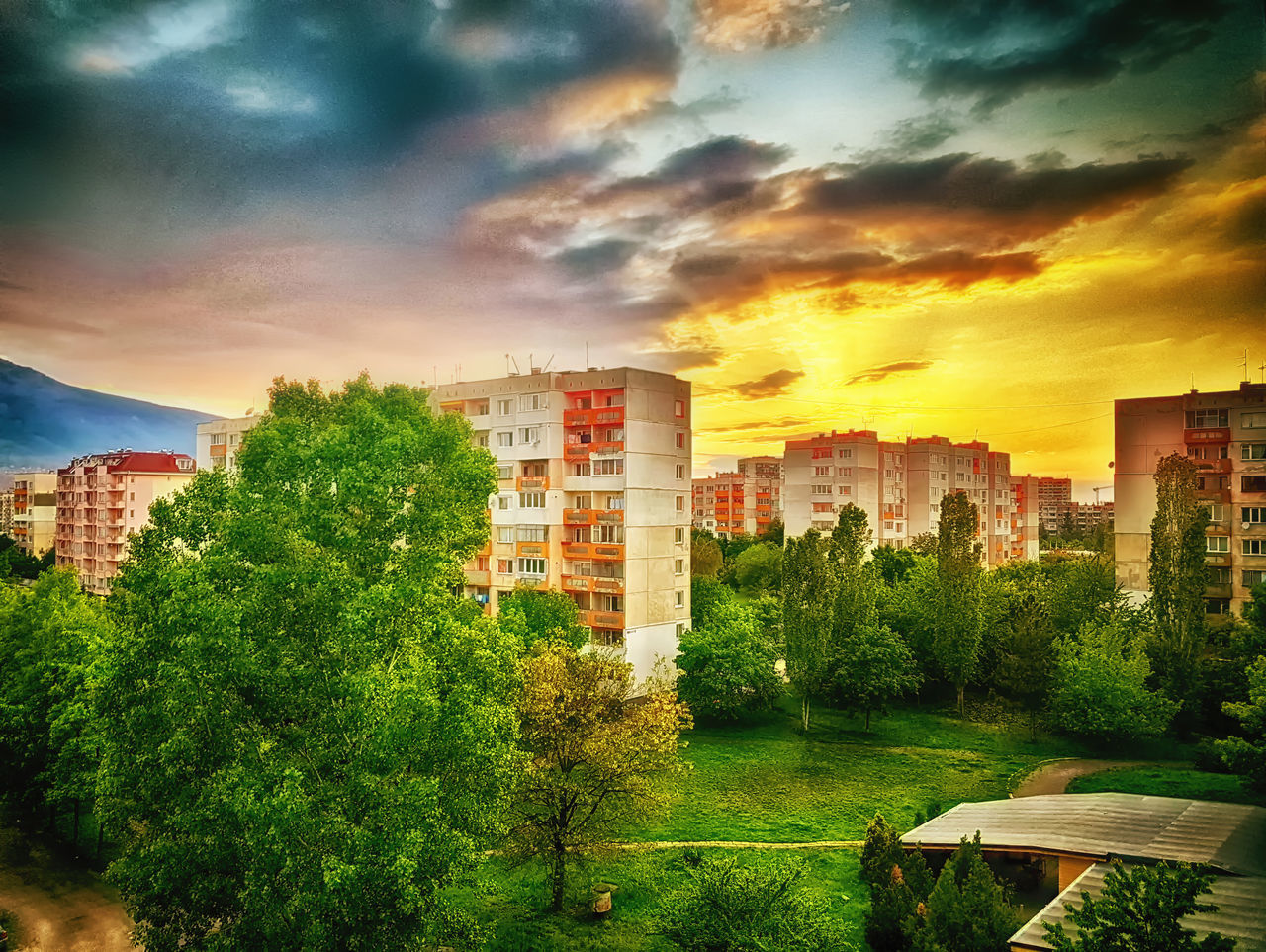 architecture, building exterior, built structure, sky, tree, cloud - sky, sunset, no people, outdoors, growth, city, nature, water, day, cityscape, beauty in nature