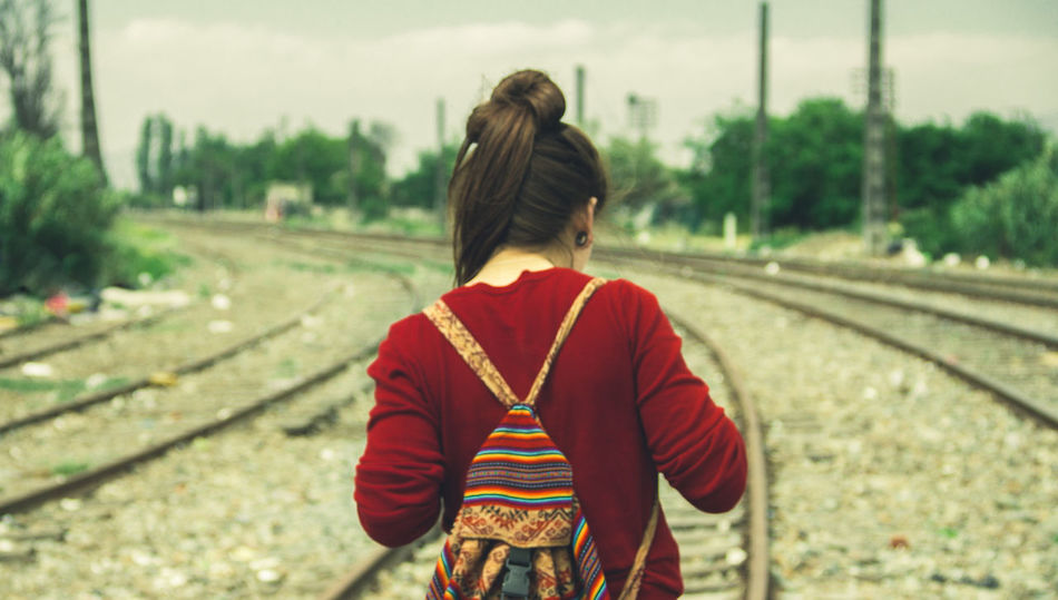 Adult Casual Clothing Day Focus On Foreground Nature One Person Outdoors People Railroad Track Real People Rear View Sky Standing Tree Young Adult