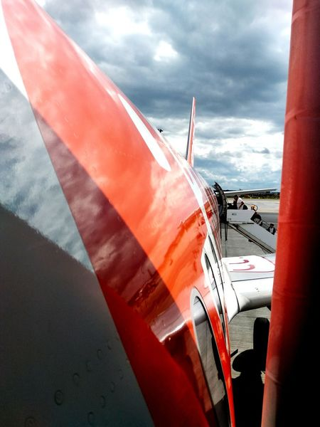 Transportation Mode Of Transport Airplane Outdoors Sky Airport AirPlane ✈ Boarding EasyJet Flying Orange Color Schönefeld Airport