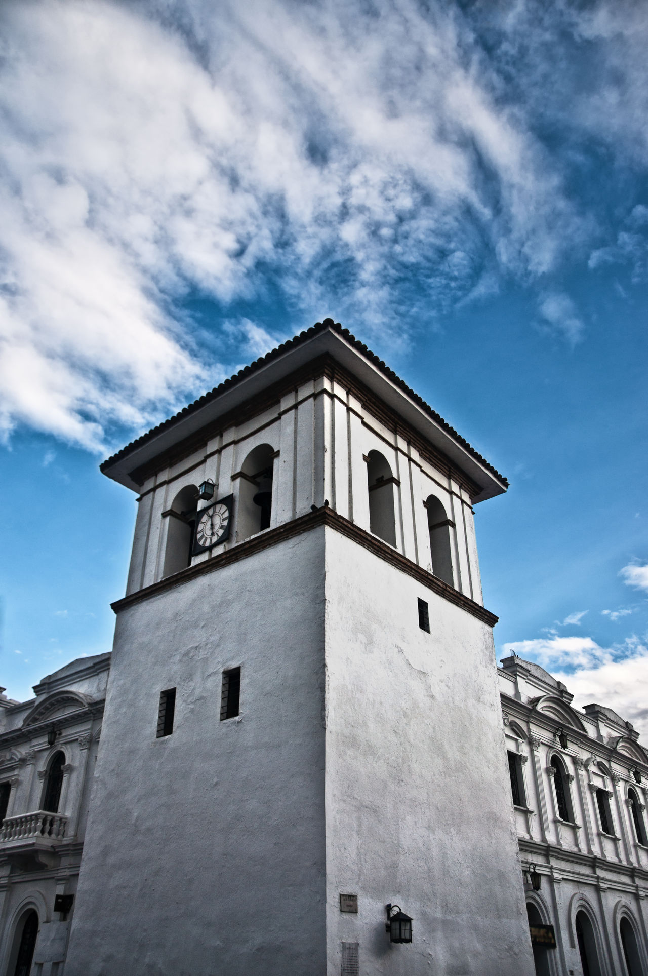 The colonial clock tower of Popayan, Colombia. Architectural Architecture Blue Building Clock Clocktower Clouds Colonial Day Exterior Historic History Landmark Old Outdoors Religion Sky Spanish Street Time Tower Travel Urban White