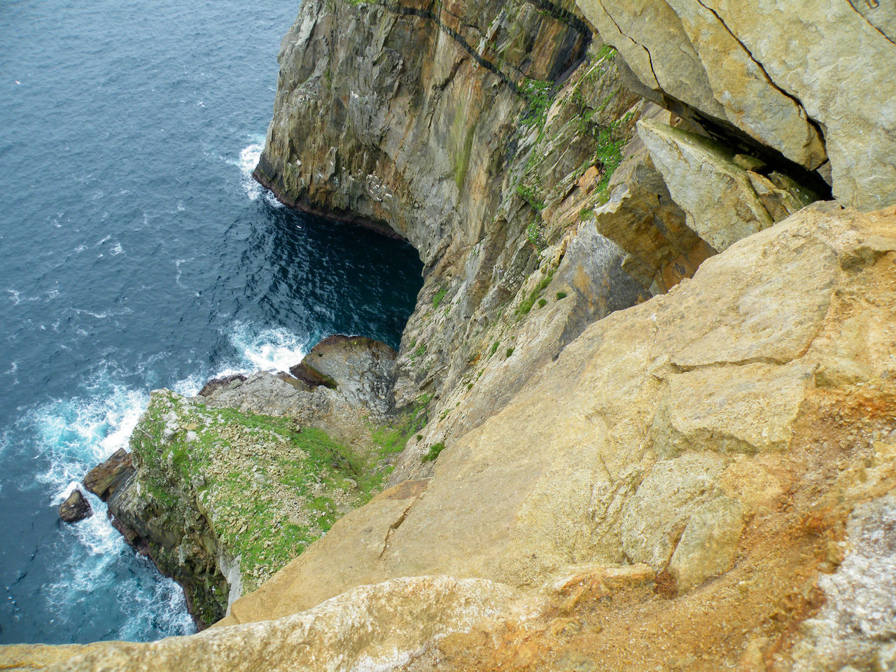 High Angle View Of Cliff At Sea Shore