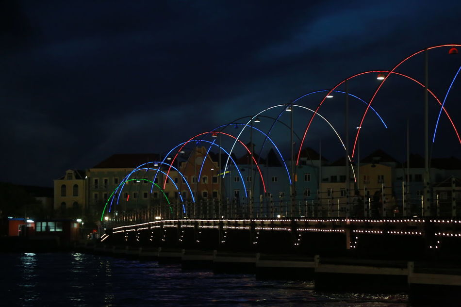 Architecture Bridge - Man Made Structure Building Exterior Built Structure City Illuminated Night No People Outdoors Ponton Bridge Curacao River Travel Destinations Water Waterfront