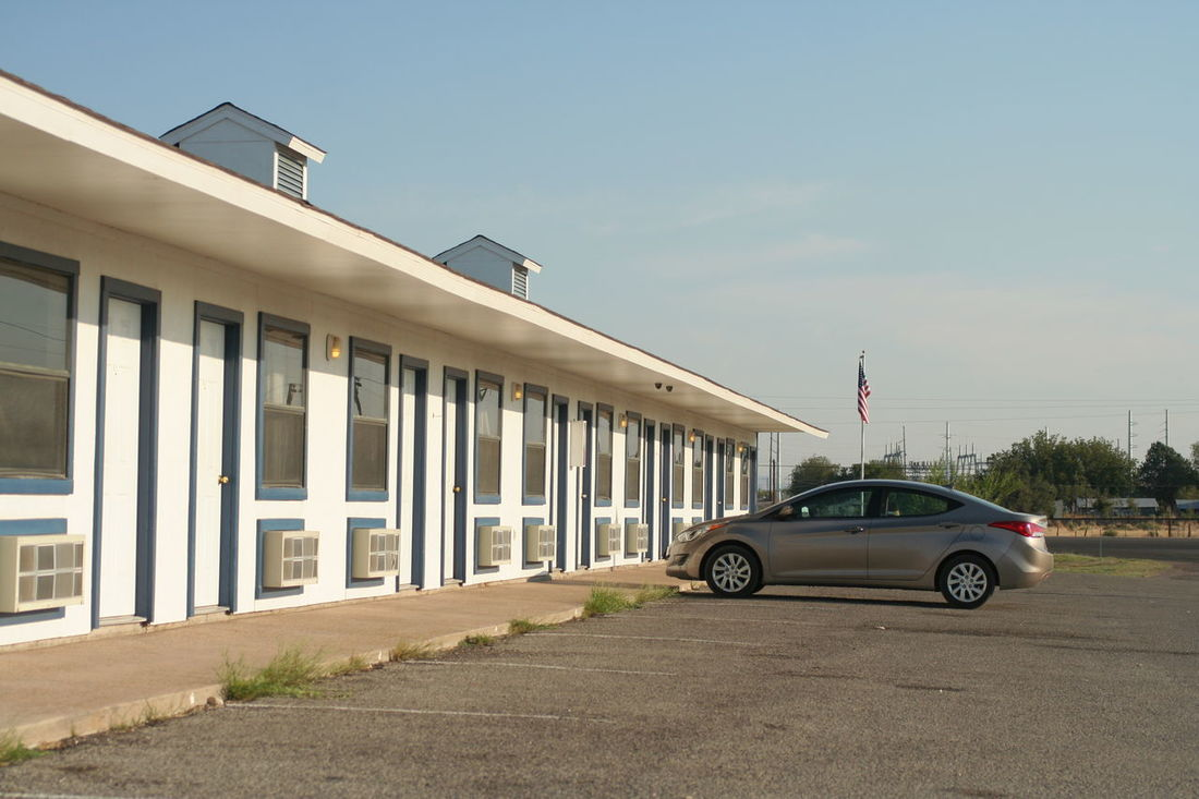 Motel in Texas American Architecture Building Exterior Car Marfa Texas Motel Outdoors Parked Road Texas USA