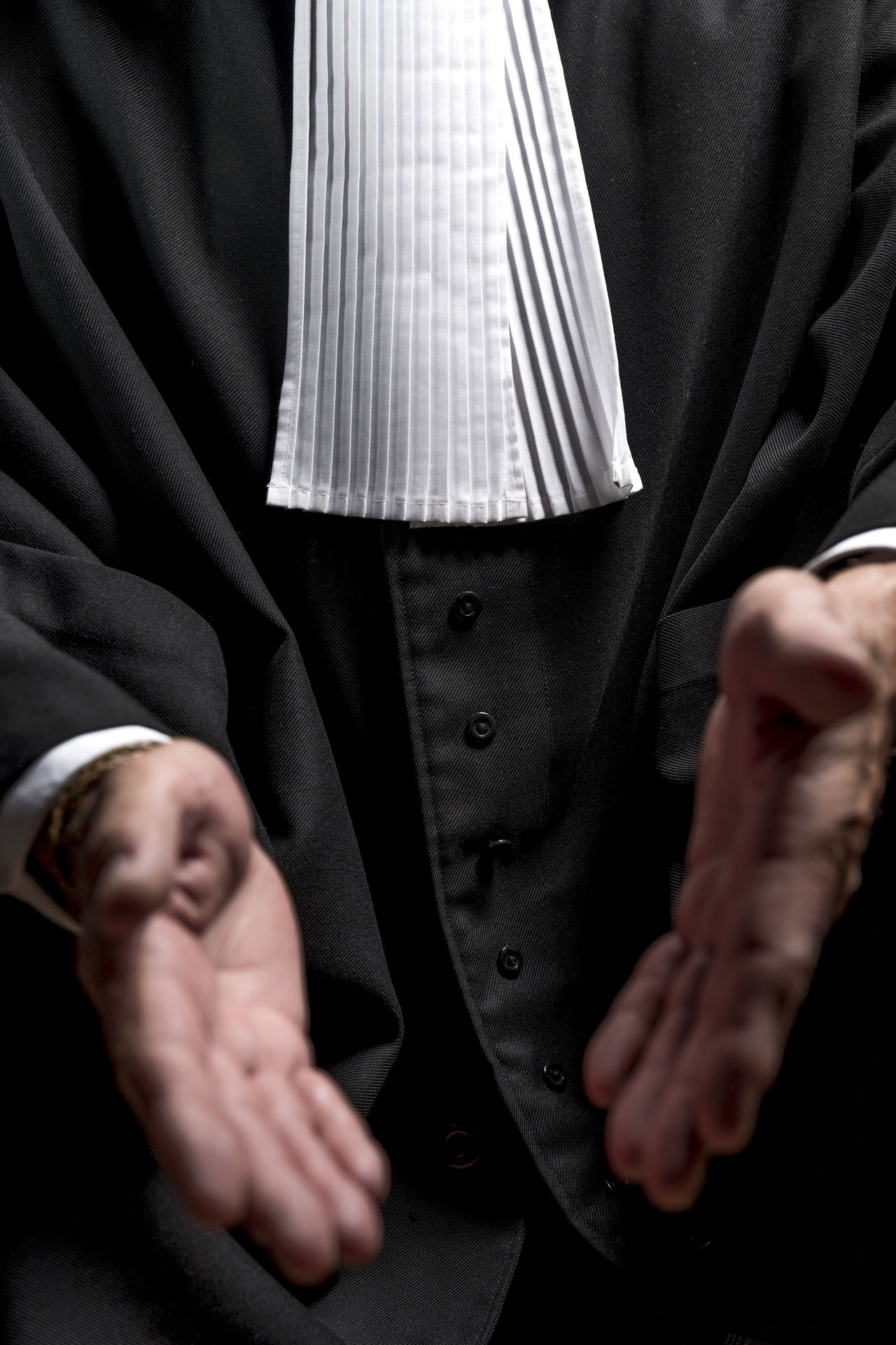Laywer in robe gown with hands Authority Close-up Court Crime Criminal Decision Fairness Gown Guilt Hand Honest Indoors  Justice Law Lawyer Man Midsection Professional Real People Rule Sentence Talking Trial Tribunal Wisdom
