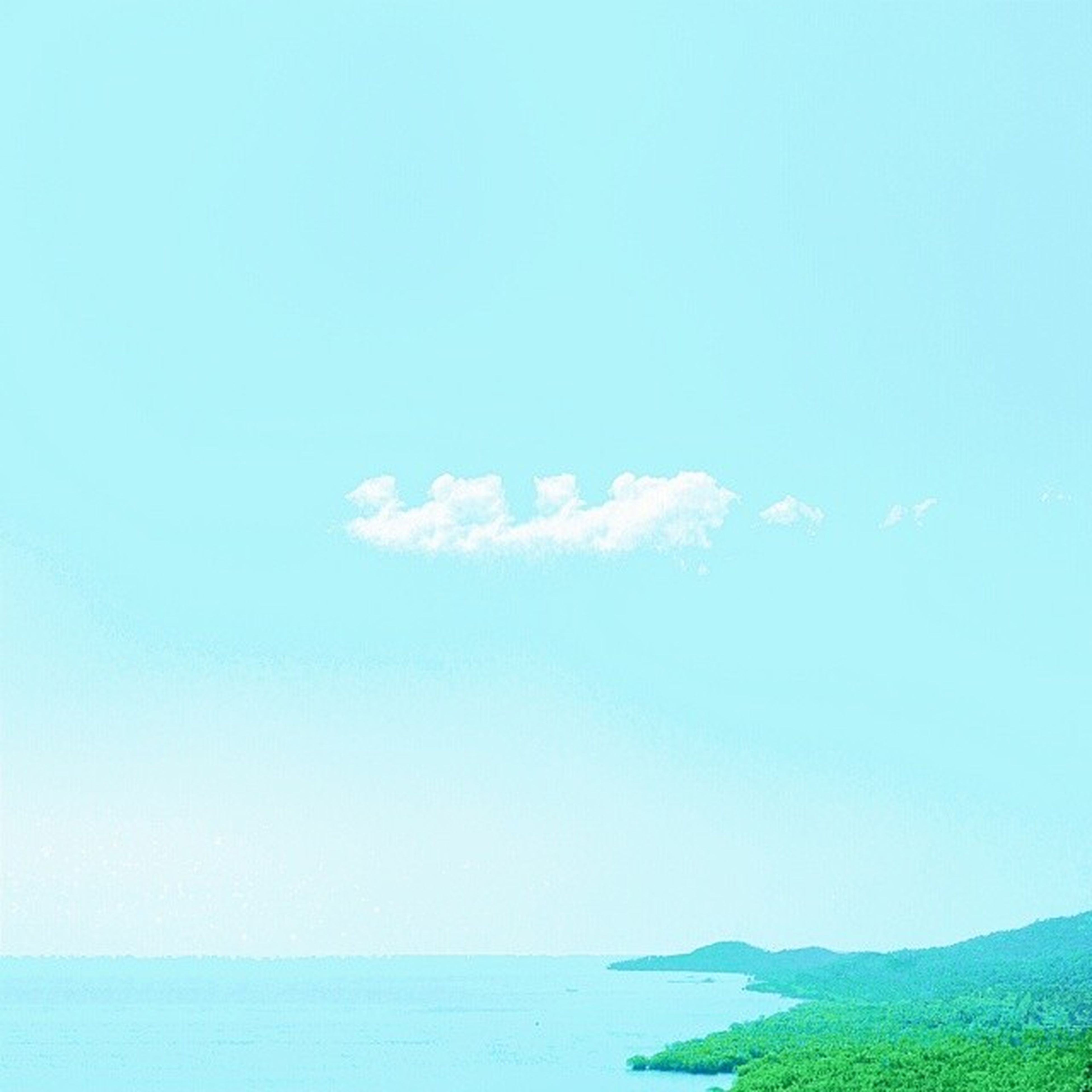 tranquil scene, blue, tranquility, copy space, sea, scenics, beauty in nature, clear sky, water, horizon over water, nature, idyllic, sky, day, remote, non-urban scene, waterfront, outdoors, no people, seascape