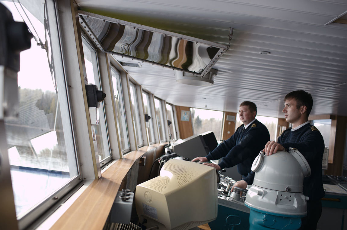 Boat Boating Captain Caucasian Control Cruise Man Navigation Officer Navigator  Pilot Profession Rudder Russia Steer Travel Vacation Vessel Wheel Work Yachting