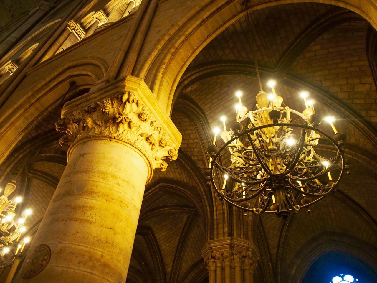 architecture, low angle view, built structure, illuminated, indoors, no people, history, religion, place of worship, travel destinations, architectural column, day, close-up