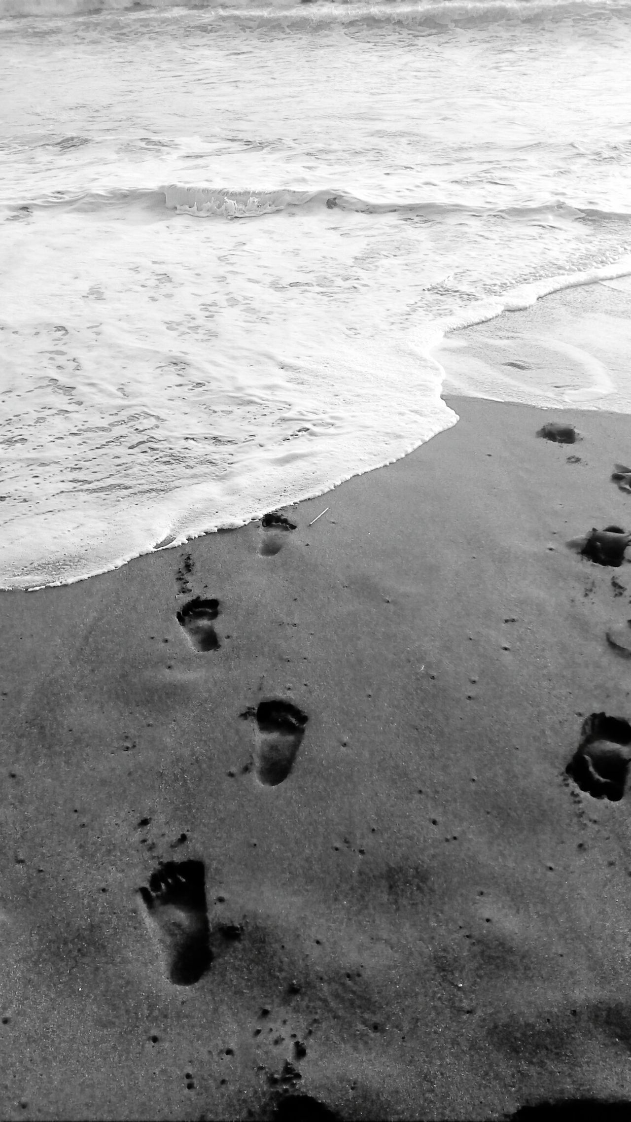 Footprints in the sand Beach Sand Nature Outdoors No People Philippines Eyeem Philippines Blackandwhite Mobilephotography Mobilephotographyphilippines Snoworld.one/bestshot The Great Outdoors - 2017 EyeEm Awards