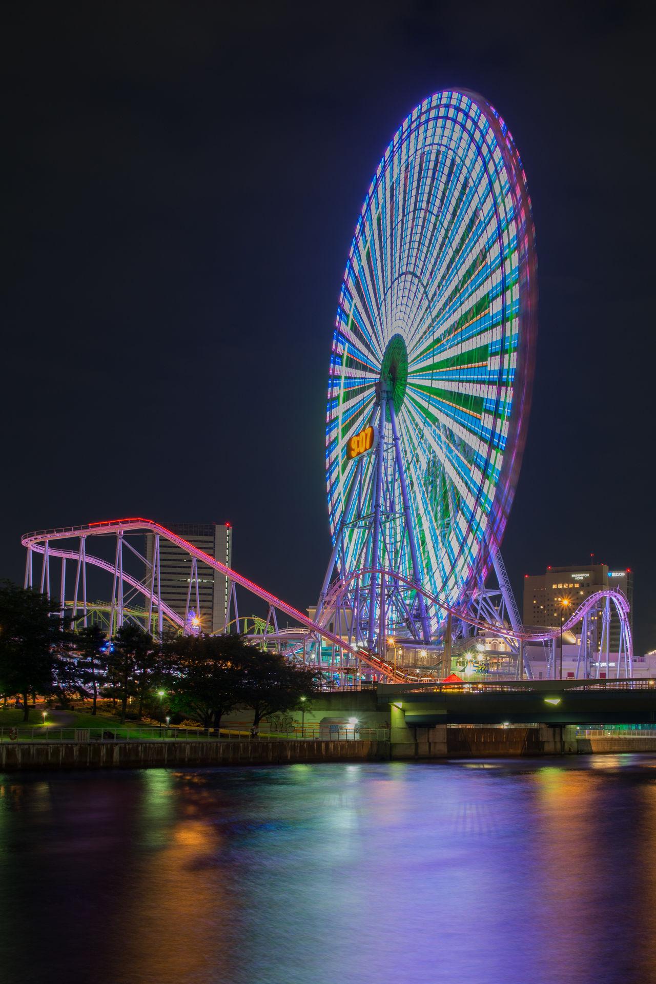 Cosmo World, Yokohama, Japan Amusement Park Amusement Park Ride Big Wheel Built Structure City Ferris Wheel Illuminated Japan Modern Multi Colored Night No People Outdoors River Travel Destinations Waterfront Yokohama