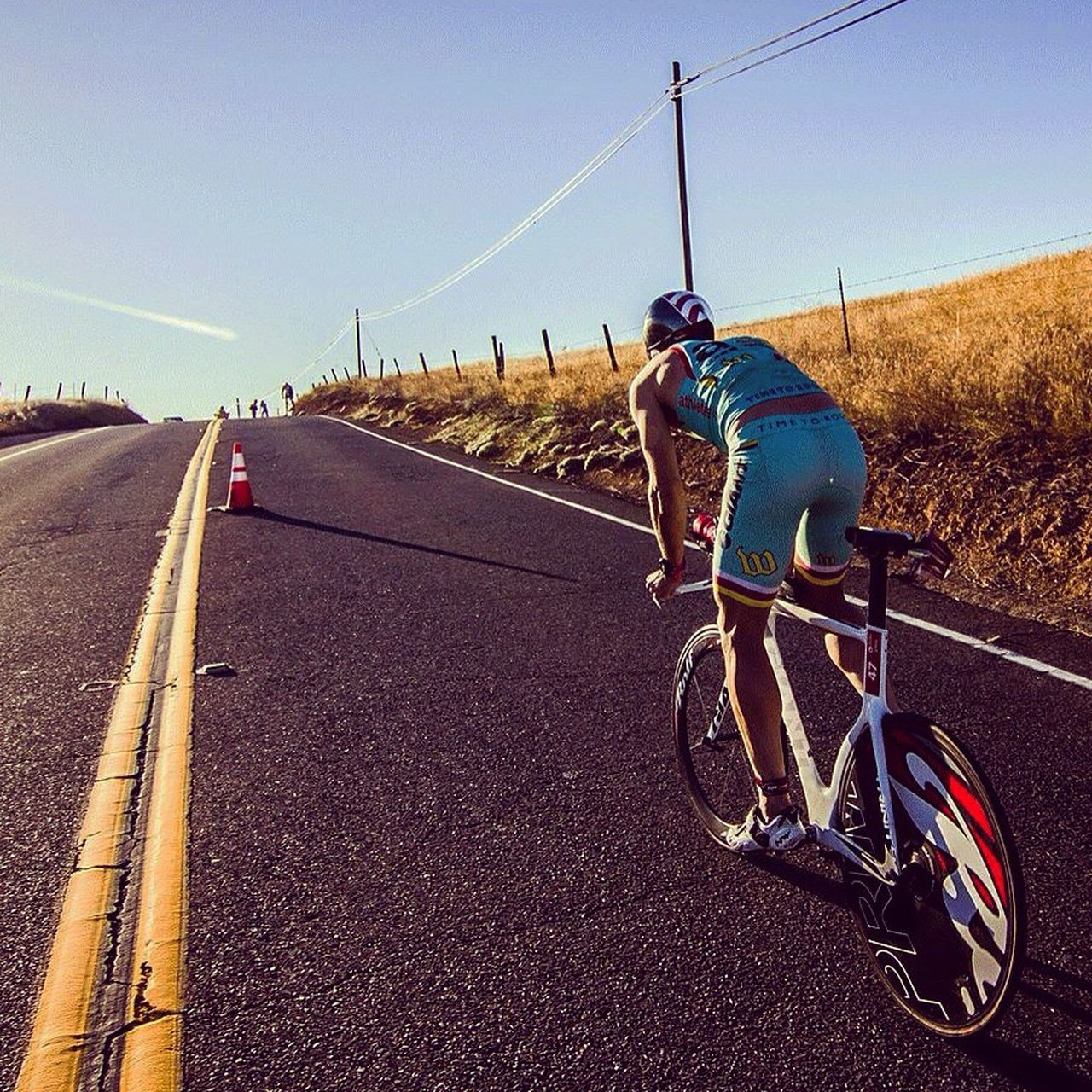 Riding off into the sunset. TRIATHLON Challenge Bike Bicycle Race Street Road Hill Flare Sun Solar Flare Photography Sports Photography Photographer Photooftheday Canon Canonphotography Canon7d  Canon_photography Canon_photos Canon_offical Tokina11-16f2.8 Tokina