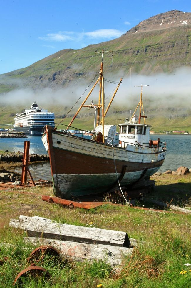Beached fishing boat and cruise ship in Iceland Boat Calm Cloud - Sky Iceland Mountain Range Nautical Vessel Seyðisfjörður Tranquil Scene Voyage Of The Vikings