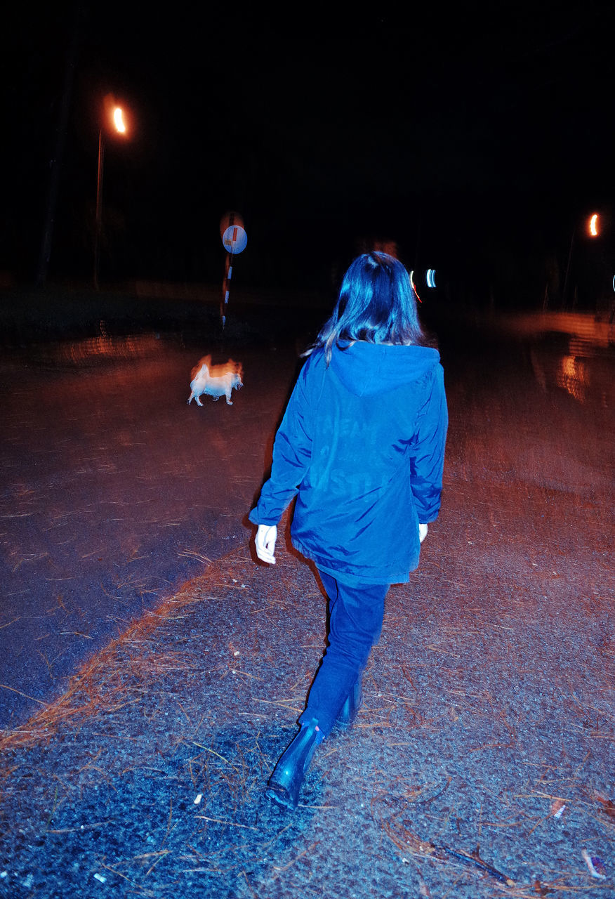 night, illuminated, full length, real people, walking, leisure activity, one person, motion, lifestyles, outdoors, people
