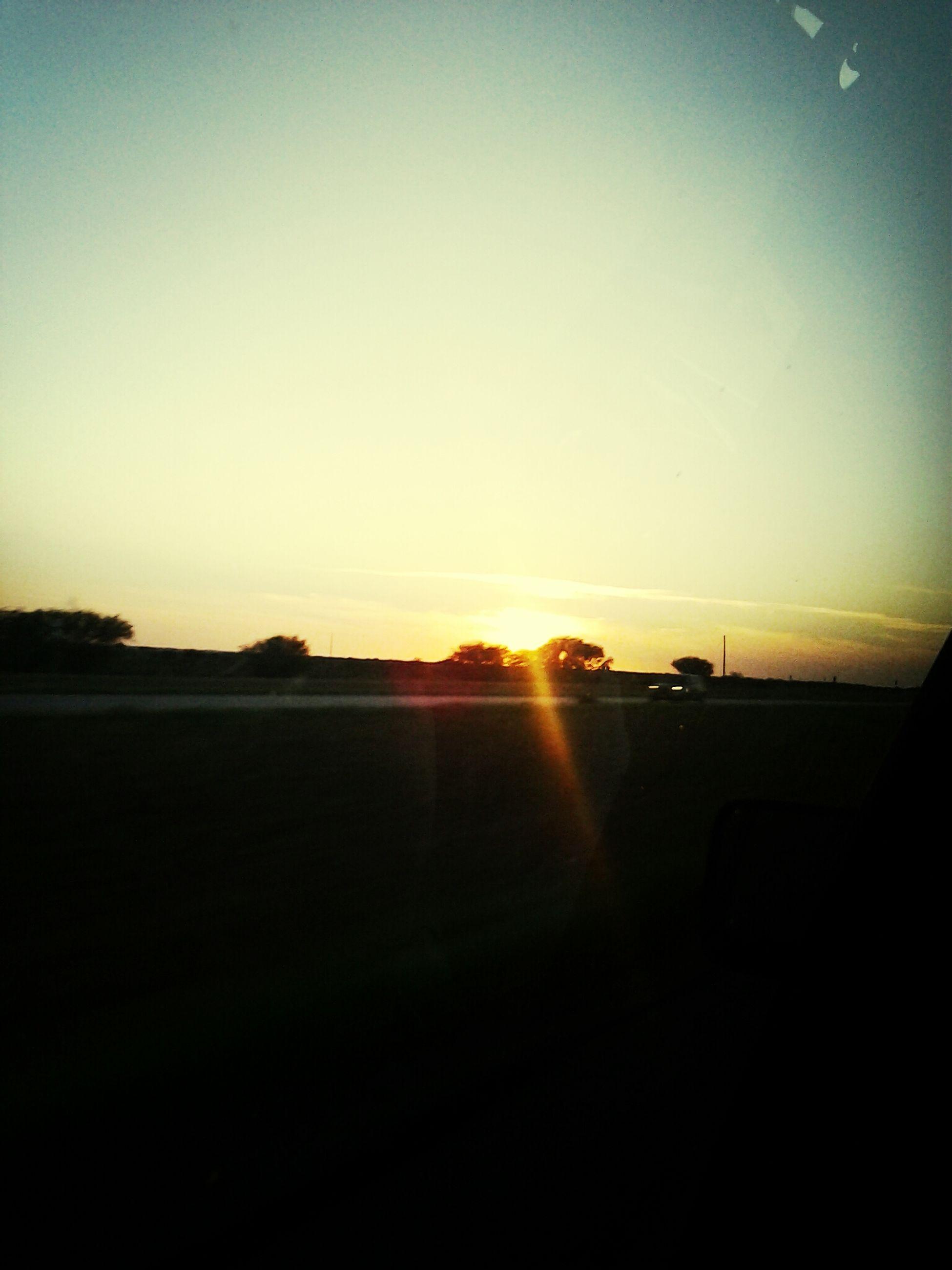 sunset, sun, silhouette, copy space, clear sky, sunlight, scenics, tranquil scene, tranquility, beauty in nature, sunbeam, orange color, nature, lens flare, sky, idyllic, outdoors, landscape, no people, dark