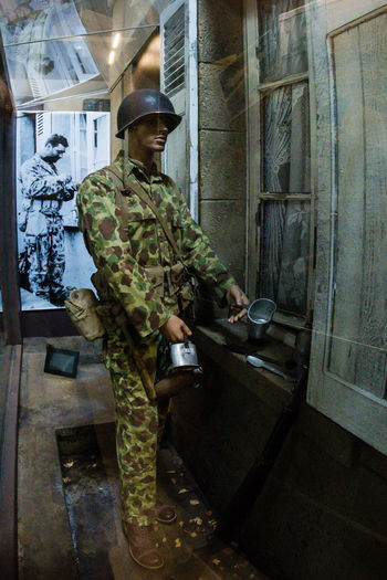 Overlord Museum, Colleville-sur-mer, Normandy, France, July 2017 D-Day II War World. Overlord Museum Army Soldier Camouflage Clothing Exhibition Exhibits Exposure Military Military Uniform Museum Omaha Beach One Person Overlord Standing Weapon