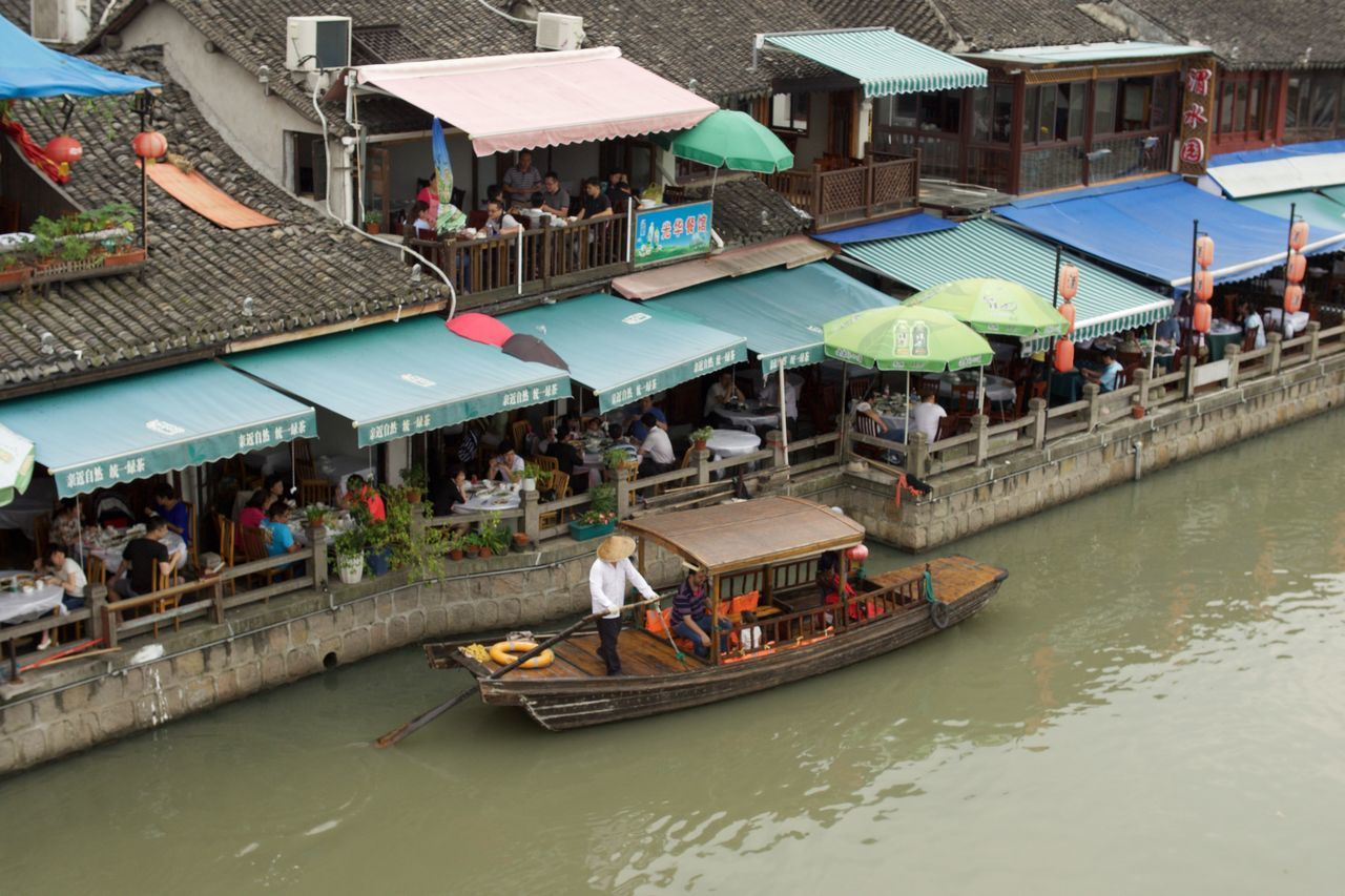 Passing all the restaurants Architecture Built Structure Canal Chinese Culture Day Gondola Group Of People Large Group Of People Leisure Activity Lifestyles Mixed Age Range Outdoors Person Restaurants Tourism Tourist Travel Destinations Vacations Water