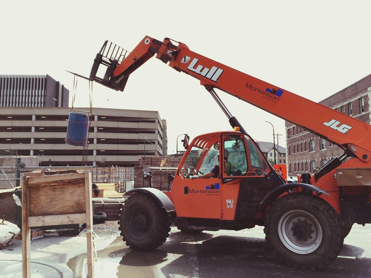 Heavy Equipment Constructionequipment Construction Crane Construction Materials Urbanphotography Streetphotography Puddle Reflections Trash Dumpster HardHats Hardwork Construction Construction Site Minnesota Minneapolis Minnesotaphotographer