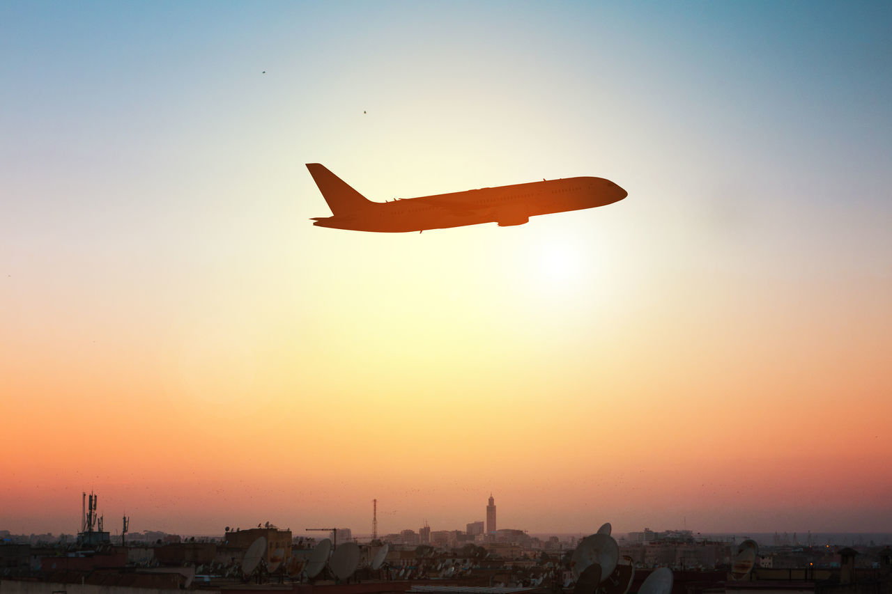 Casablanca Morocco Travel Air Vehicle Airplane Architecture Building Exterior City Cityscape Clear Sky Day Departure Destination Flying Leisure Activity Mid-air Nature Outdoors Real People Silhouette Sky Sun Sunset Transportation Travel Destinations