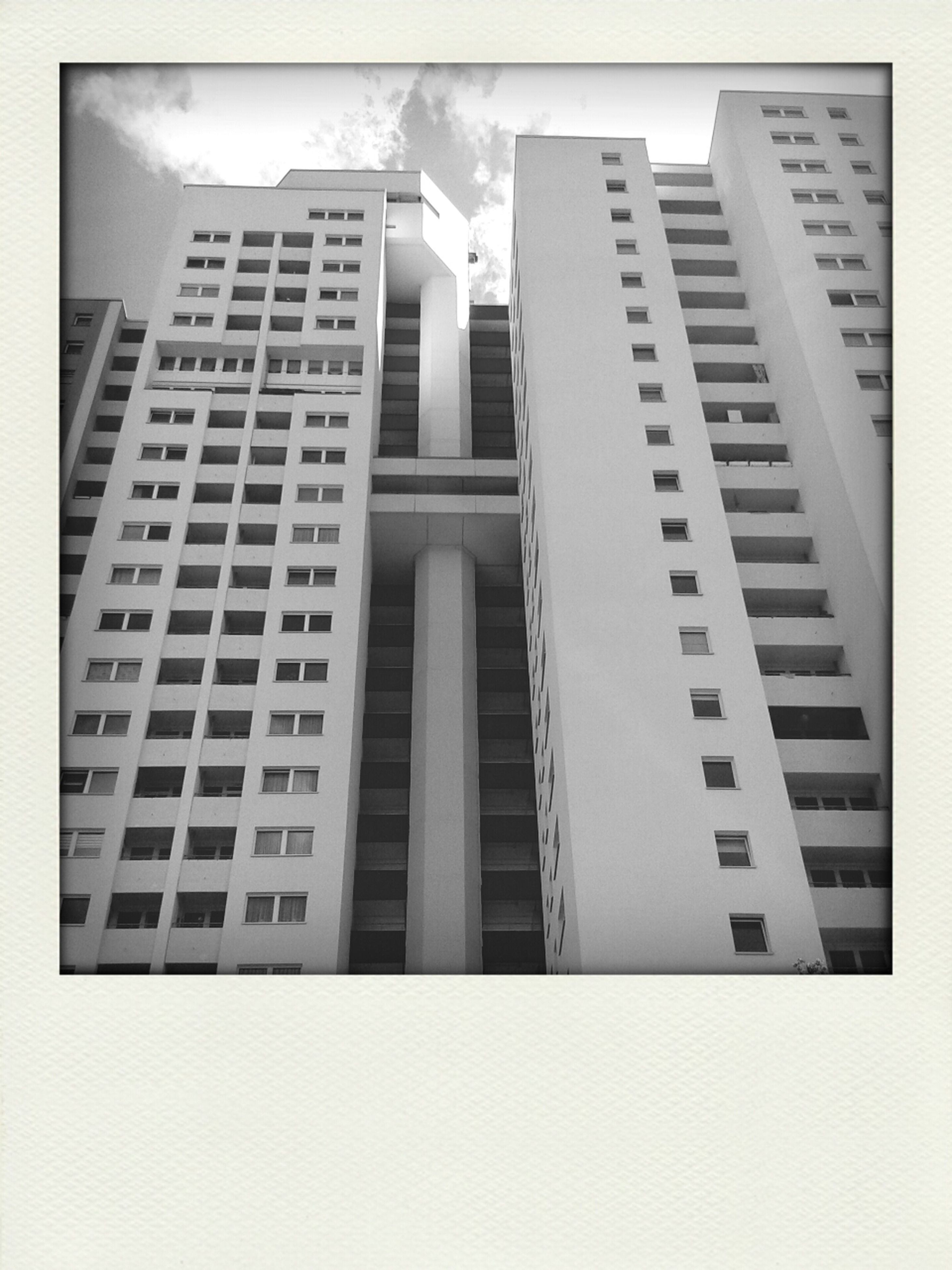 architecture, building exterior, transfer print, built structure, low angle view, auto post production filter, building, window, city, office building, modern, glass - material, residential building, day, sky, residential structure, outdoors, tall - high, no people, facade