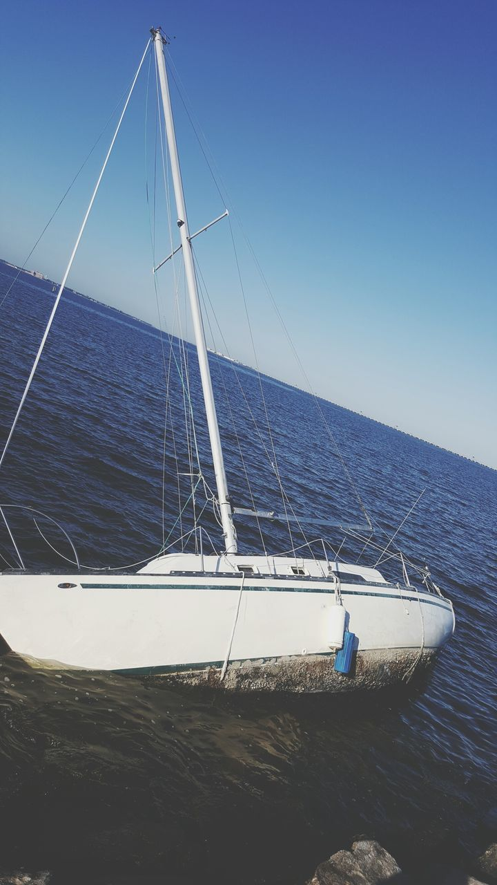 nautical vessel, water, sea, boat, transportation, nature, mode of transport, no people, day, scenics, horizon over water, clear sky, beauty in nature, outdoors, tranquil scene, sailing, tranquility, blue, sailboat, waterfront, mast, sky