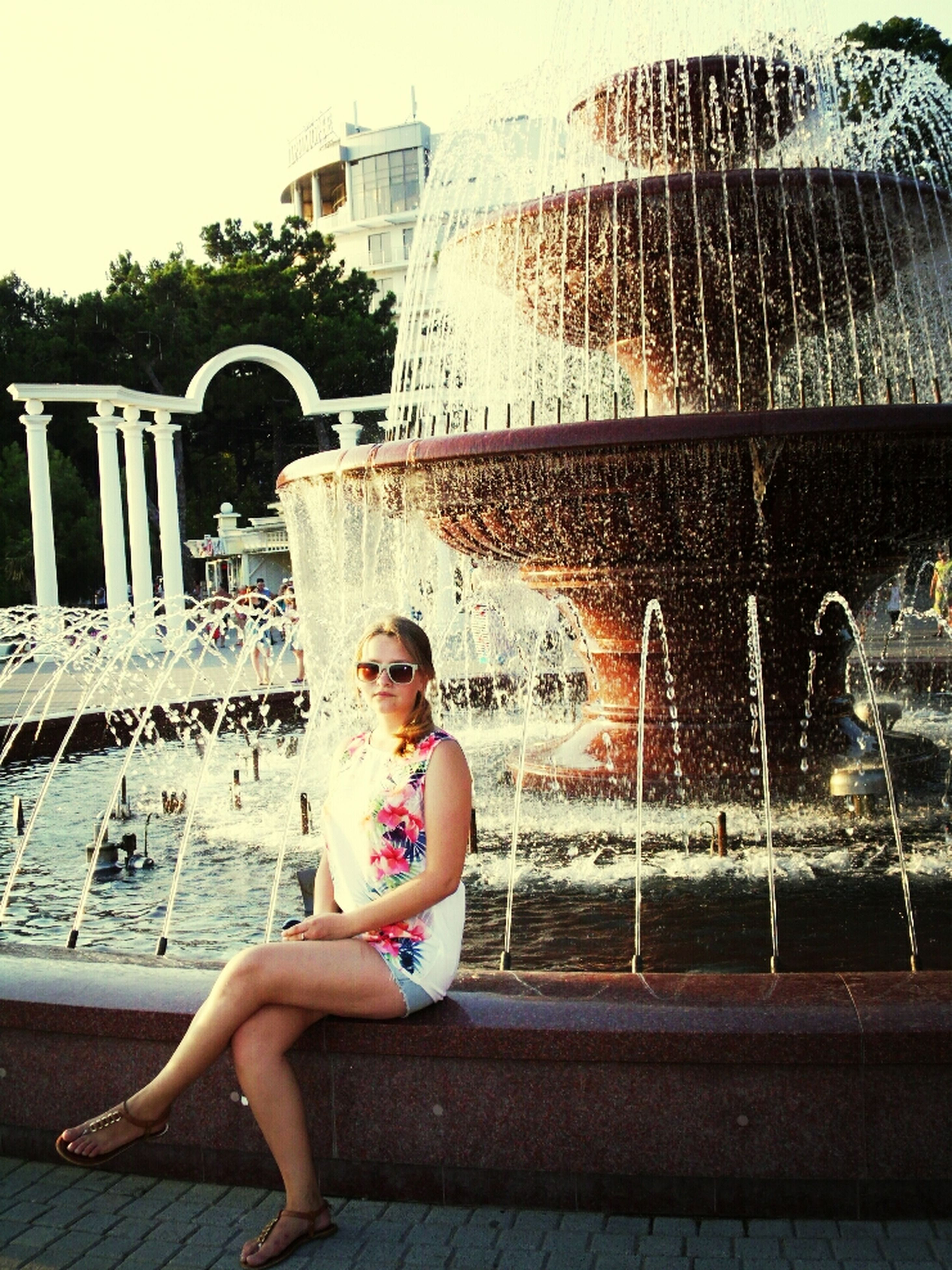lifestyles, leisure activity, water, building exterior, architecture, built structure, full length, casual clothing, person, childhood, city, elementary age, sitting, young adult, boys, standing, day, fountain