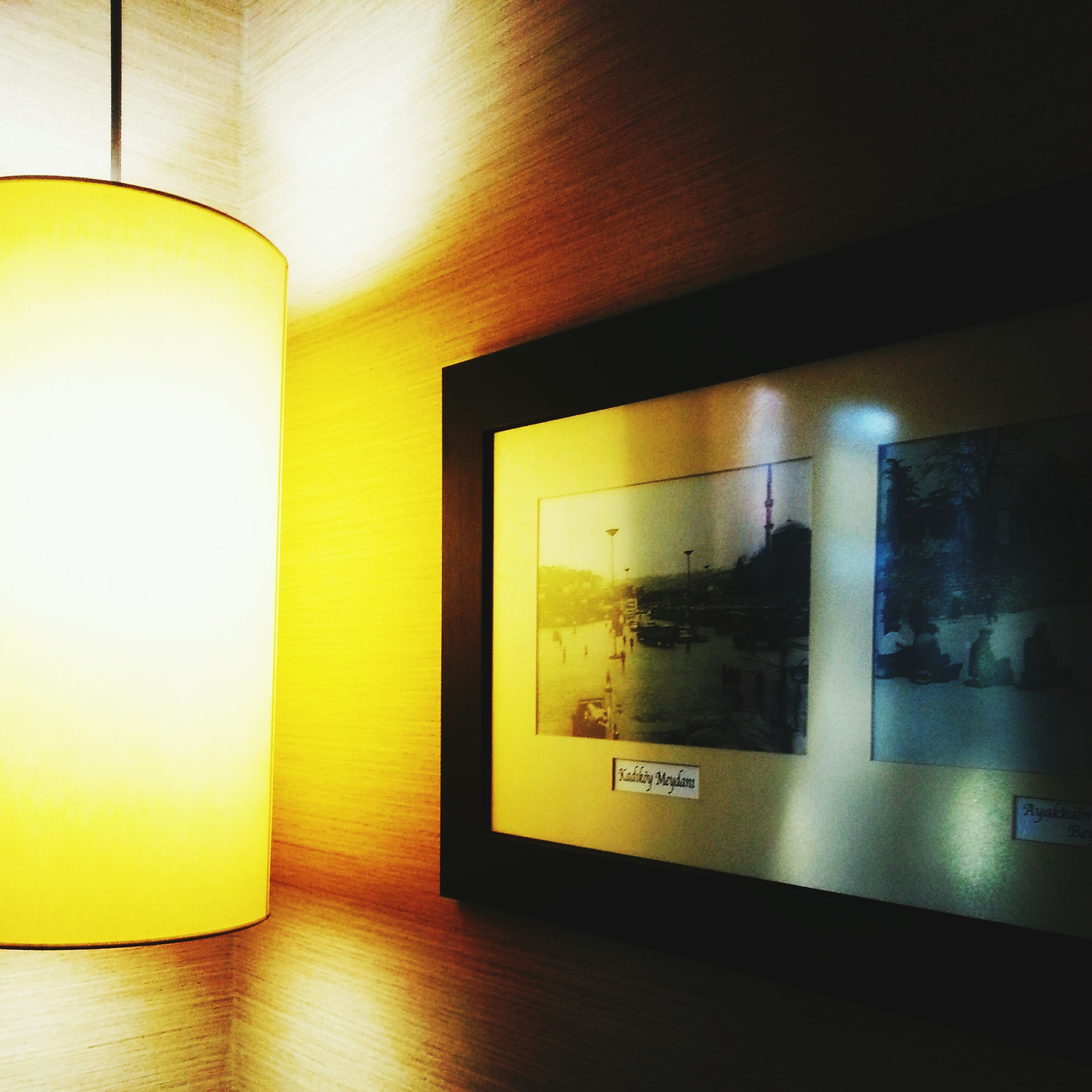 indoors, illuminated, reflection, yellow, technology, lighting equipment, glass - material, modern, no people, wall - building feature, home interior, electricity, empty, transparent, domestic room, convenience, close-up, still life, absence, table