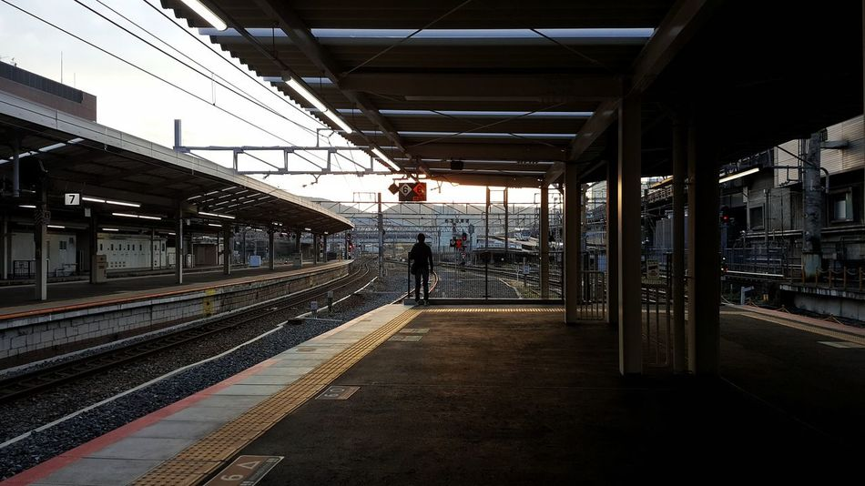 Railroad Station Transportation Railroad Station Platform Public Transportation Rail Transportation Railroad Track Train - Vehicle Day People City Architecture Sky Kyoto City City Kyoto Japan Kyoto,japan Outdoors Global Communications Streetphotography Japan Built Structure Silhouette Journey Travel Trip Long Goodbye