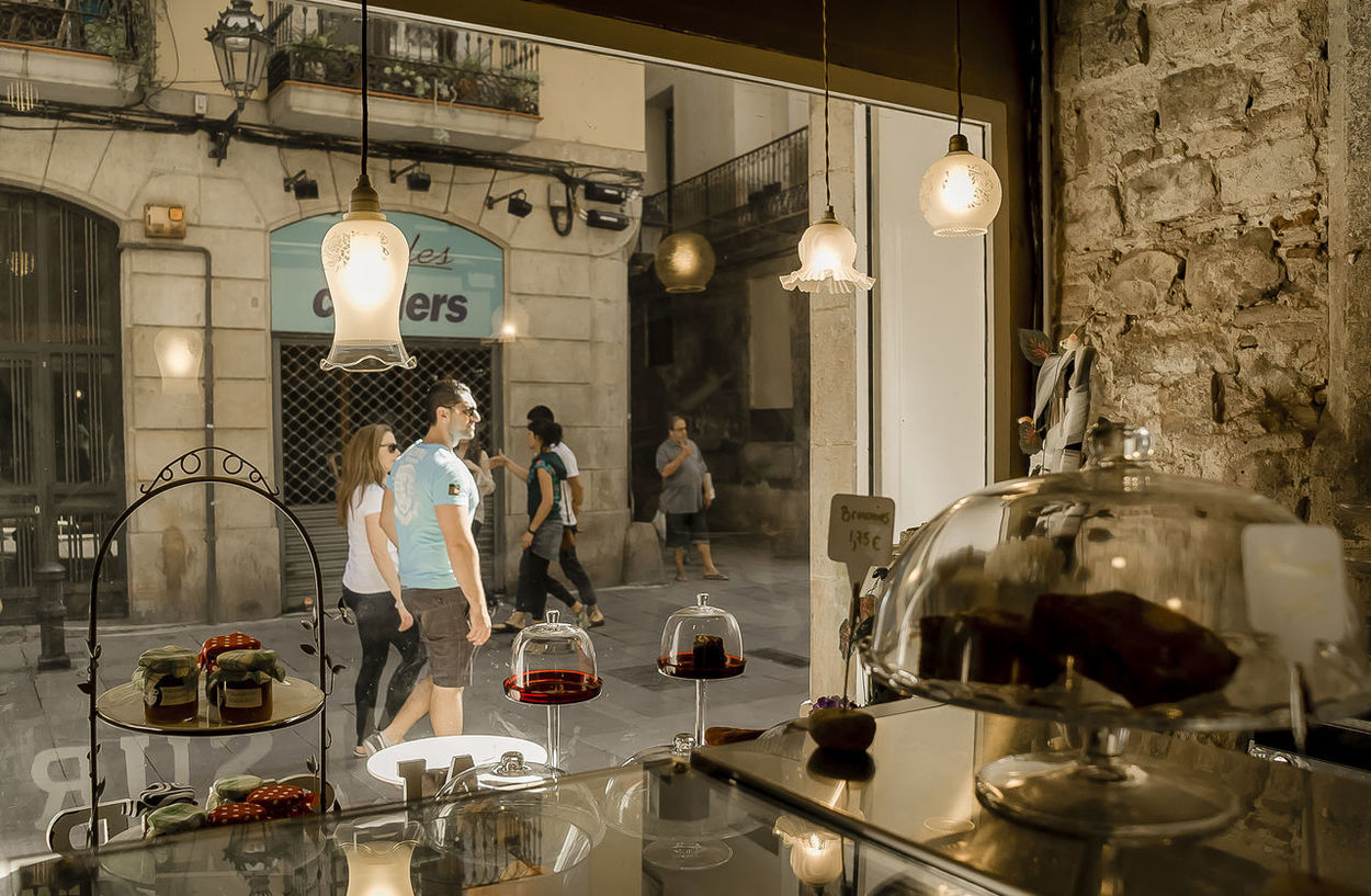 Barcelona's Old Downtown Barcelonacity Barri El Born Enjoying A Walk Enjoying Life Indoors  Looking At People Old Downtown Outdoor People Sightseeing Sightseeing Barcelona SPAIN Storefront Storefront View Street Style The Old City Tourists Urban Scenes Urban Style Urbanphotography View From Storefront