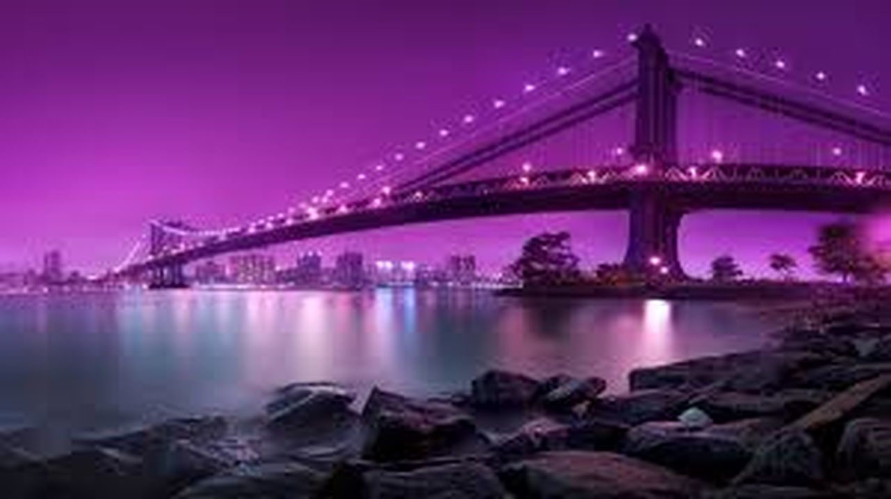 bridge - man made structure, connection, night, illuminated, engineering, architecture, built structure, transportation, travel destinations, river, suspension bridge, purple, dusk, reflection, city, long exposure, outdoors, sky, cityscape, water, no people, urban skyline, chain bridge