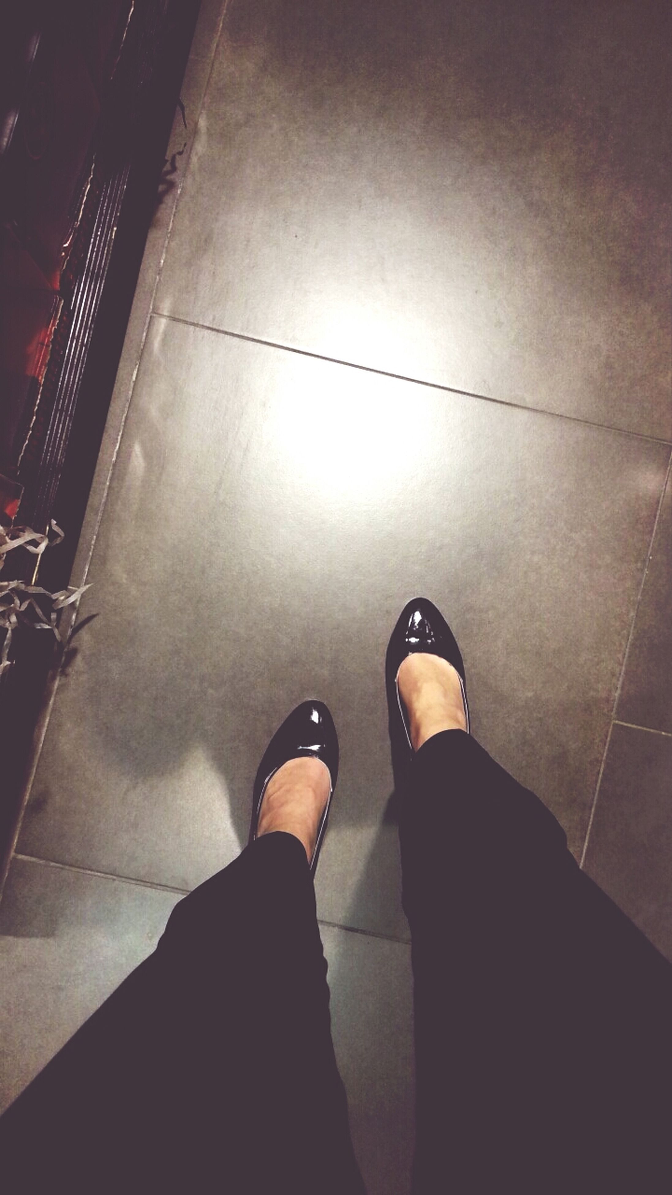 low section, person, personal perspective, lifestyles, standing, shoe, men, illuminated, night, indoors, leisure activity, human foot, high angle view, unrecognizable person, flooring, tiled floor