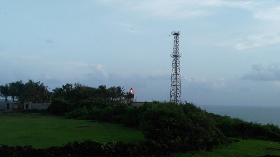 Light-House Cloud Communication Tower Communications Tower Countryside Day Field Global Communications Green Color Growth Light-House Nature No People Outdoors Riverbank Rural Scene Scenics Sky Solitude Tall Tall - High Tower Tranquil Scene Tranquility Tree