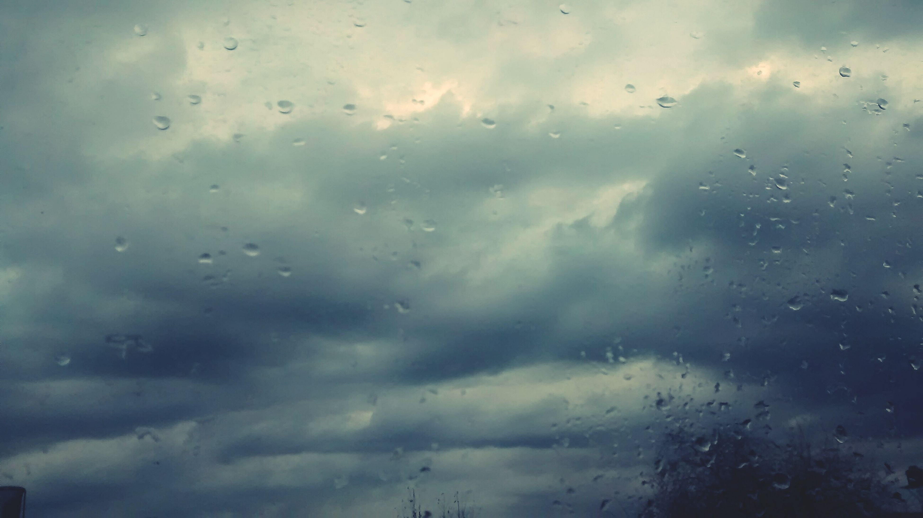 drop, sky, wet, window, weather, water, rain, transparent, cloud - sky, glass - material, indoors, raindrop, cloudy, backgrounds, full frame, cloud, glass, overcast, nature, dusk