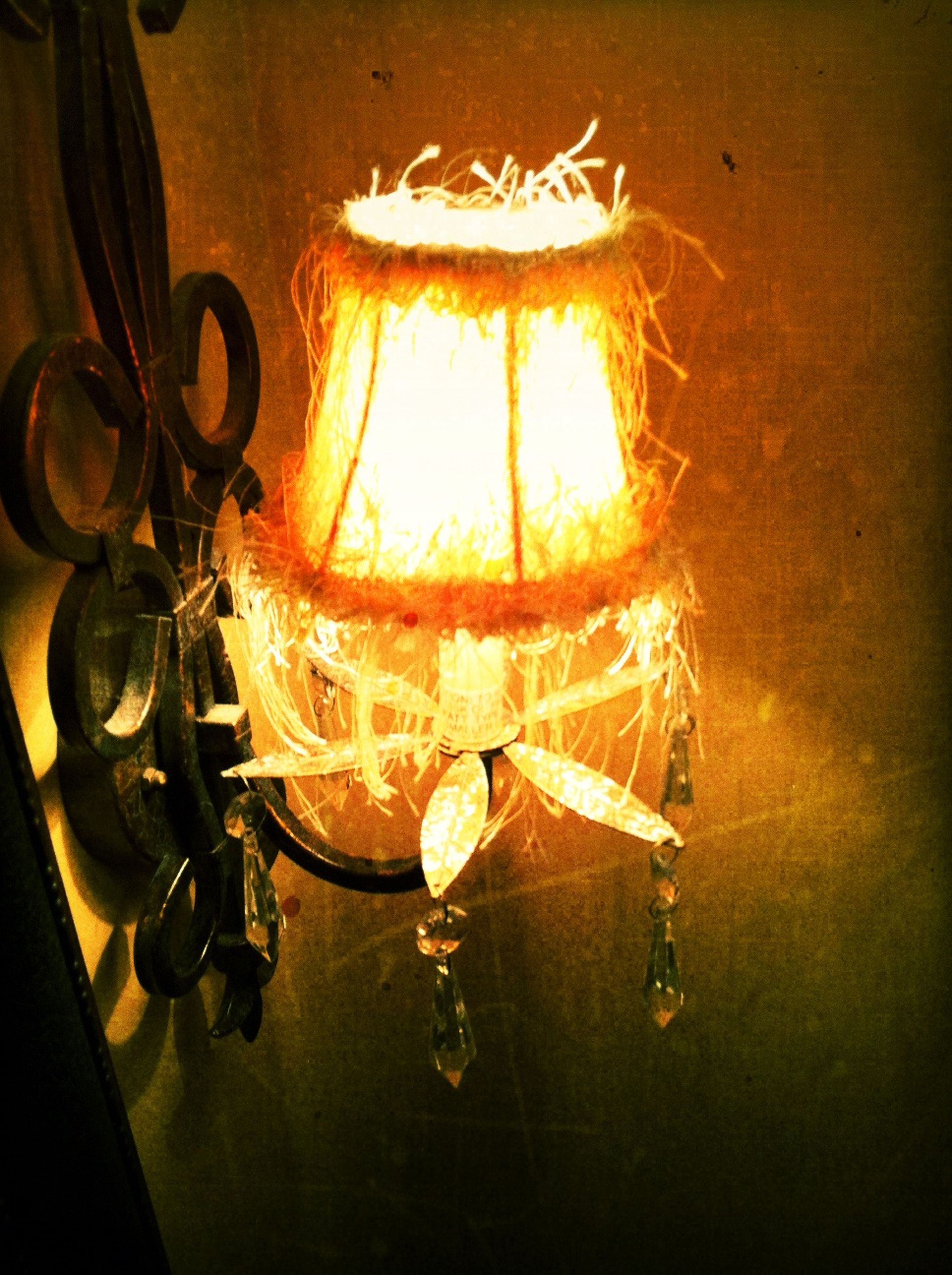indoors, close-up, illuminated, burning, glowing, metal, heat - temperature, still life, flame, no people, old-fashioned, wall - building feature, electricity, fire - natural phenomenon, hanging, old, wood - material, lighting equipment, home interior, light - natural phenomenon