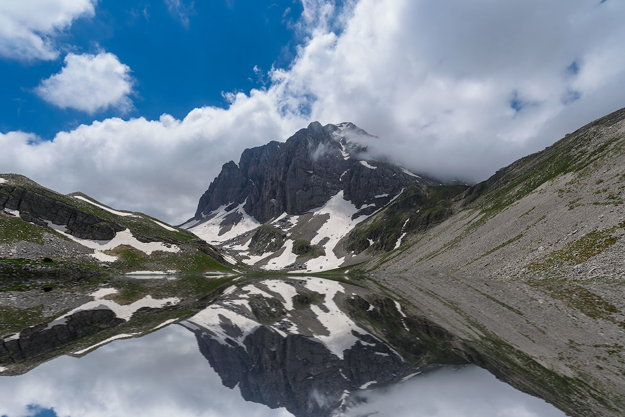 The Xeroloucha alpine lake on Mt Timfi Alpine Cloud - Sky Clouds Cloudy Day Epirus Glacier Greece Hellas Ice Lake Landscape Mountain Mountains Mountaintop Peak Pond Reflect Reflecting Pool Reflection Reflections Reflections In The Water Snow Water Winter